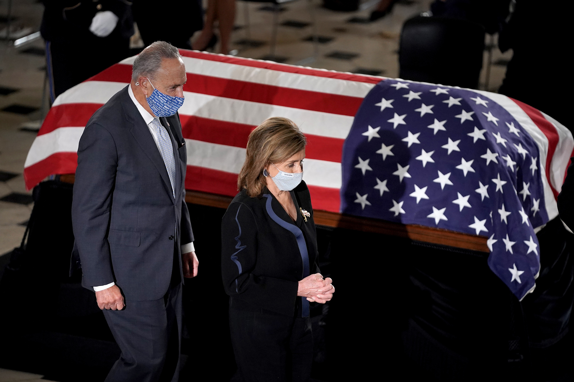 Speaker Nancy Pelosi and Senate Minority Leader Charles Schumer pay their respects to the late Associate Justice Ruth Bader Ginsburg as her casket lies in state during a memorial service in her honor in the Statuary Hall of the US Capitol in Washington, DC, on September 25.
