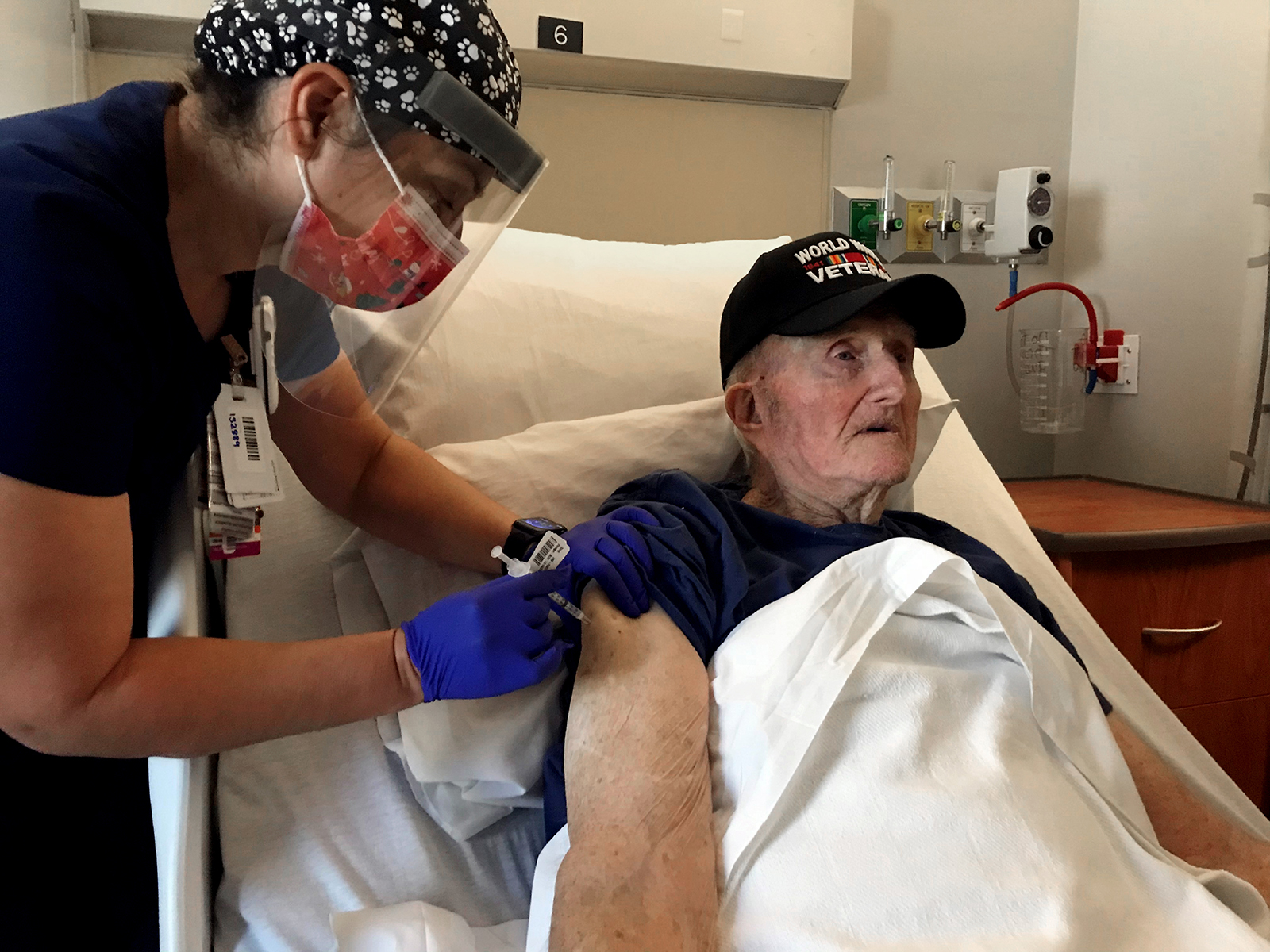 World War II veteran John Mohun, 94, receives the Pfizer-BioNTech Covid-19 vaccine at the Veterans Affairs agency in Phoenix on Tuesday, Dec. 16, 2020.