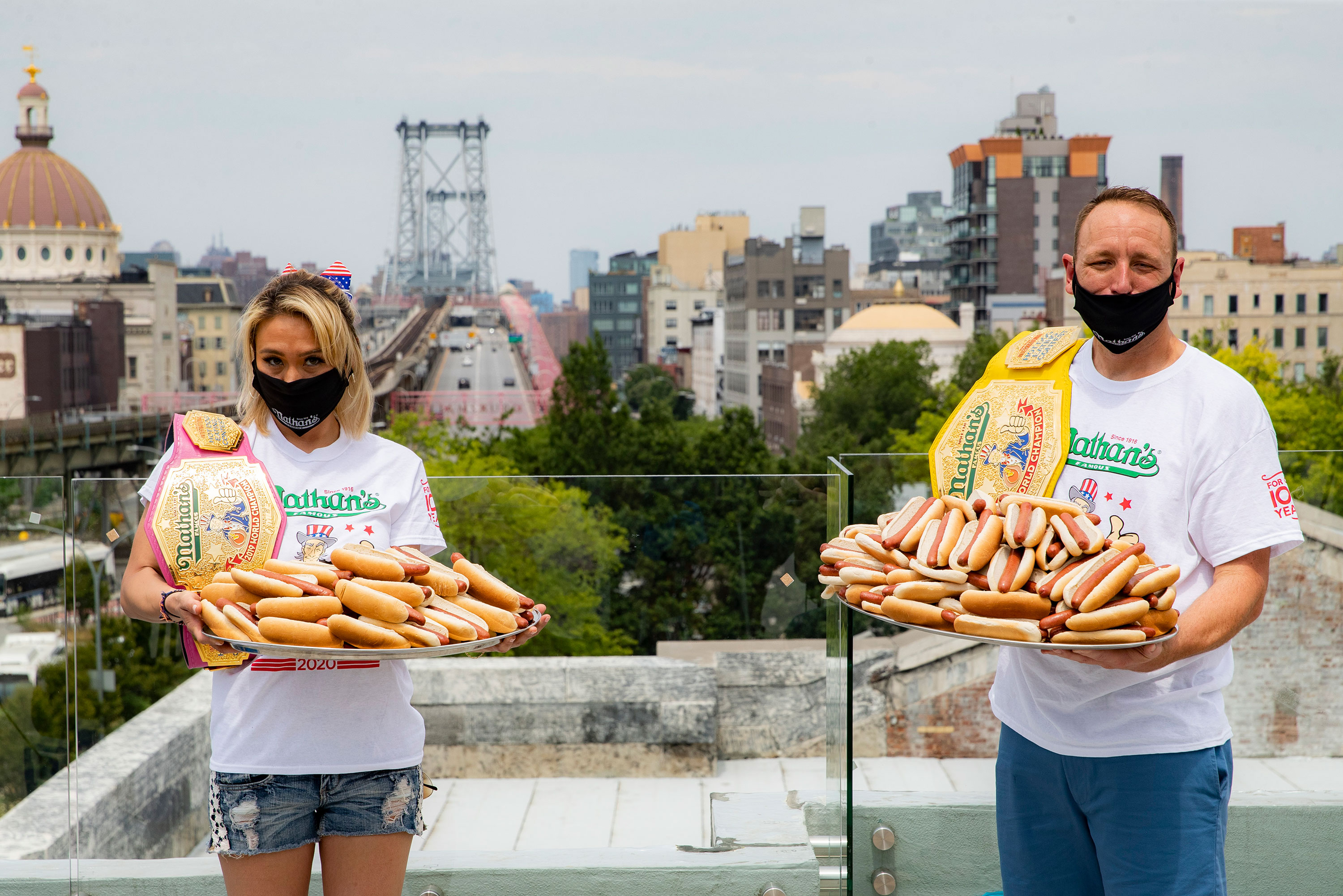 Competitive eaters Miki Sudo, left, and Joey Chestnut, right, pose for a photograph at the weigh-in the day before the Nathan's Famous July Fourth hot dog eating contest on July 3 in New York.