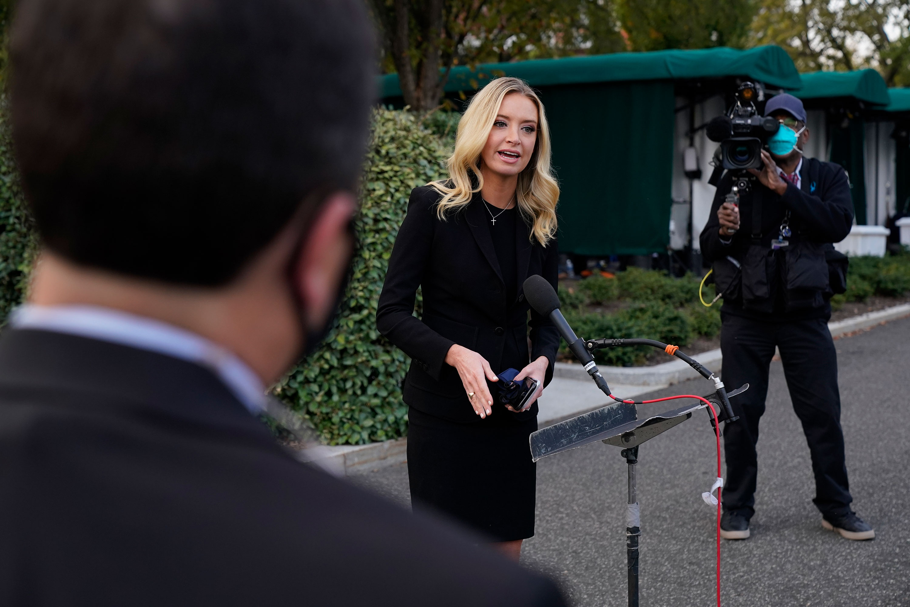 White House press secretary Kayleigh McEnany speaks with reporters outside the White House on October 4 in Washington, DC.