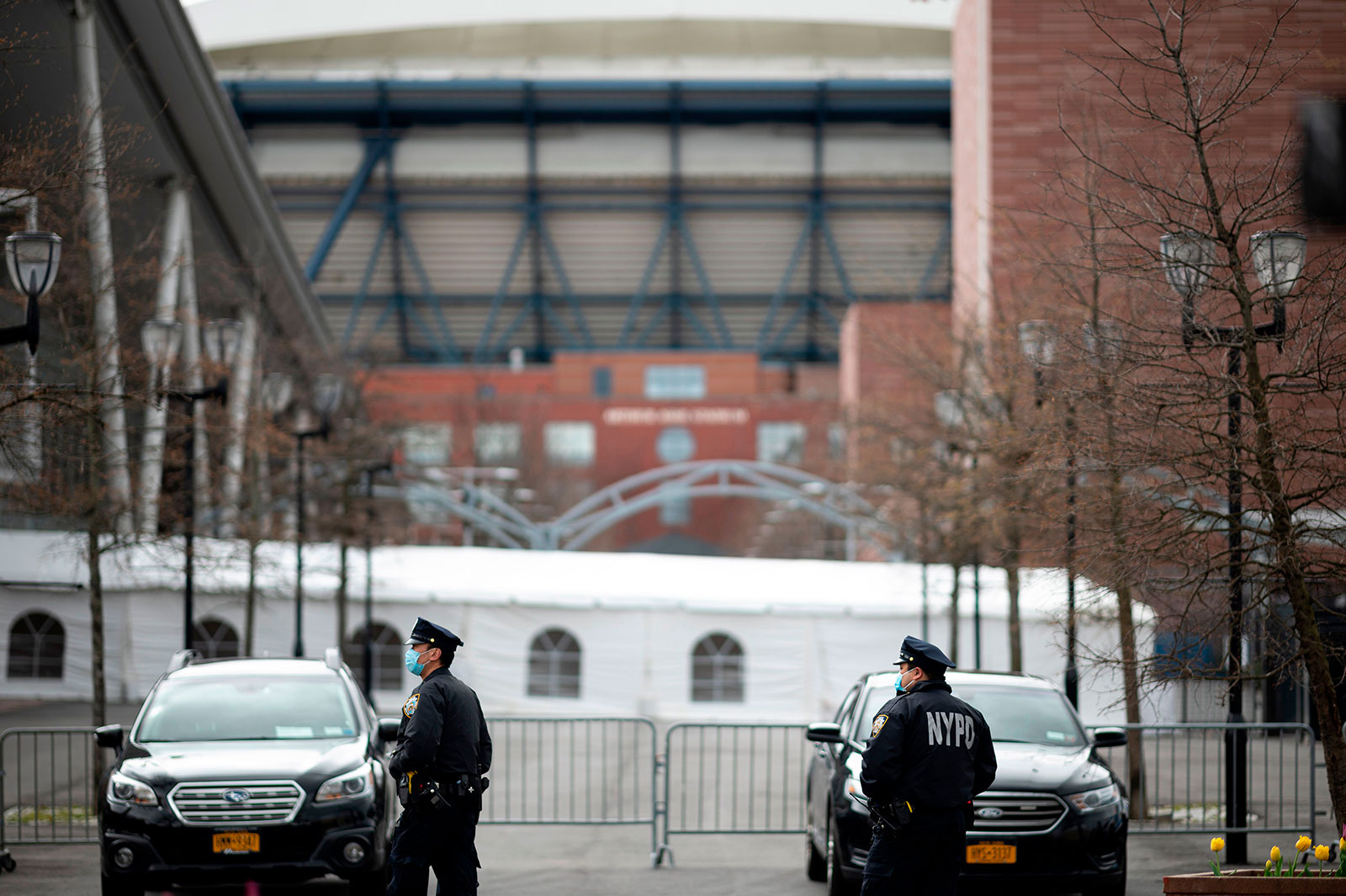 NYPD officers stand outside a temporary hospital located at the USTA Billie Jean King National Tennis Center in Queens, New York, on April 10.