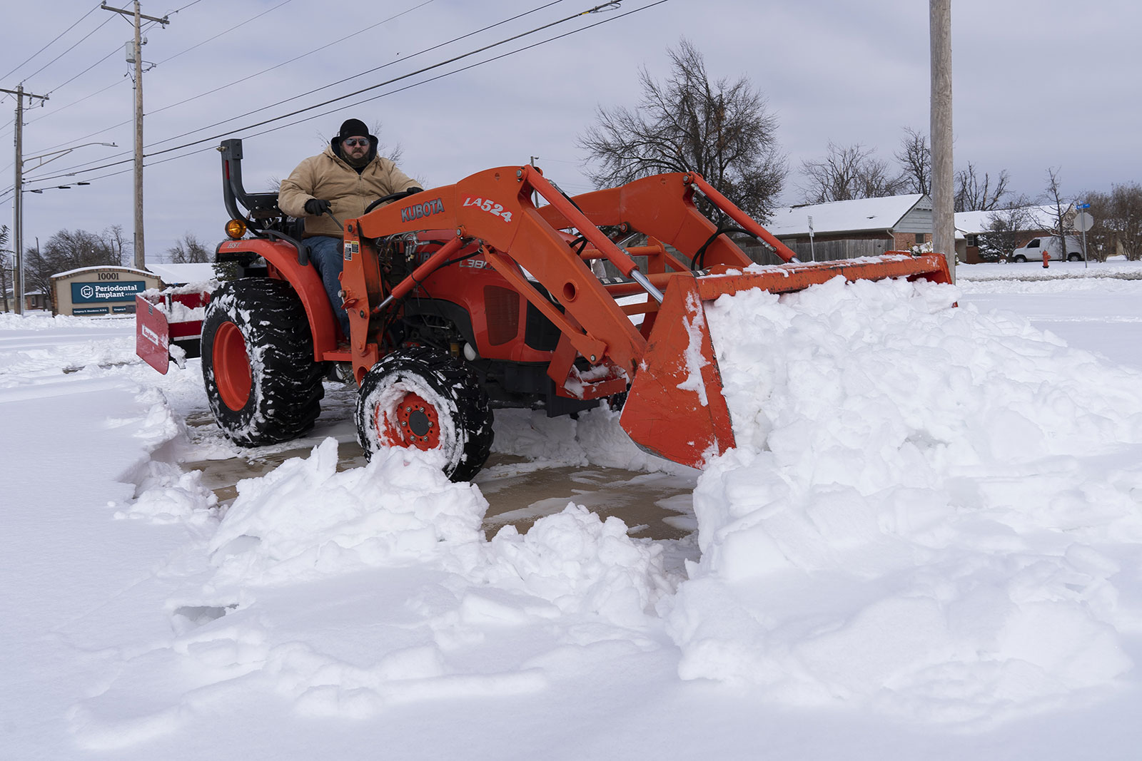 A man plows a parking lot in Oklahoma City on Wednesday, February 17.