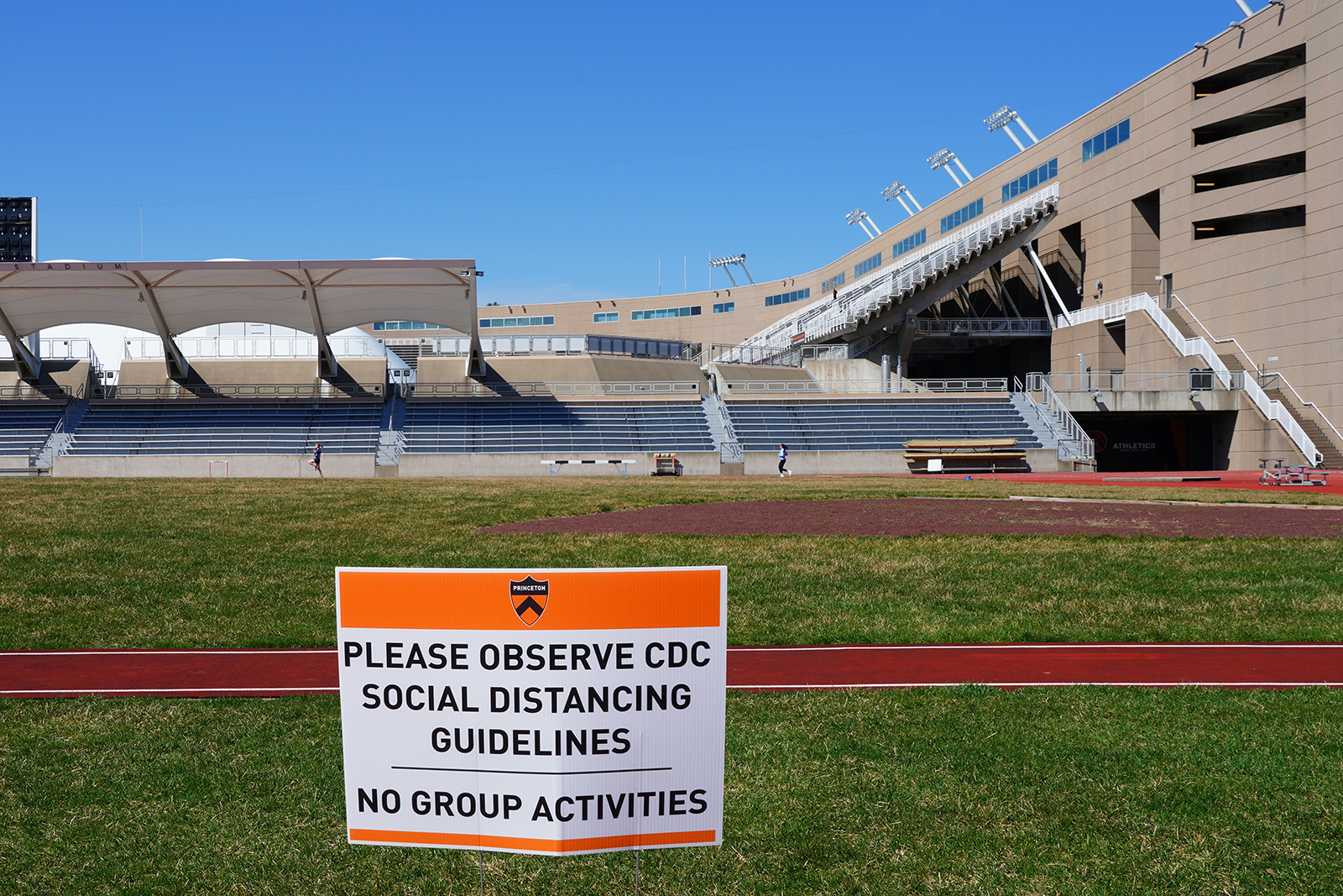 A sign warns the public about social distancing in the wake of Covid-19 on the campus of Princeton University, New Jersey, on March 26.