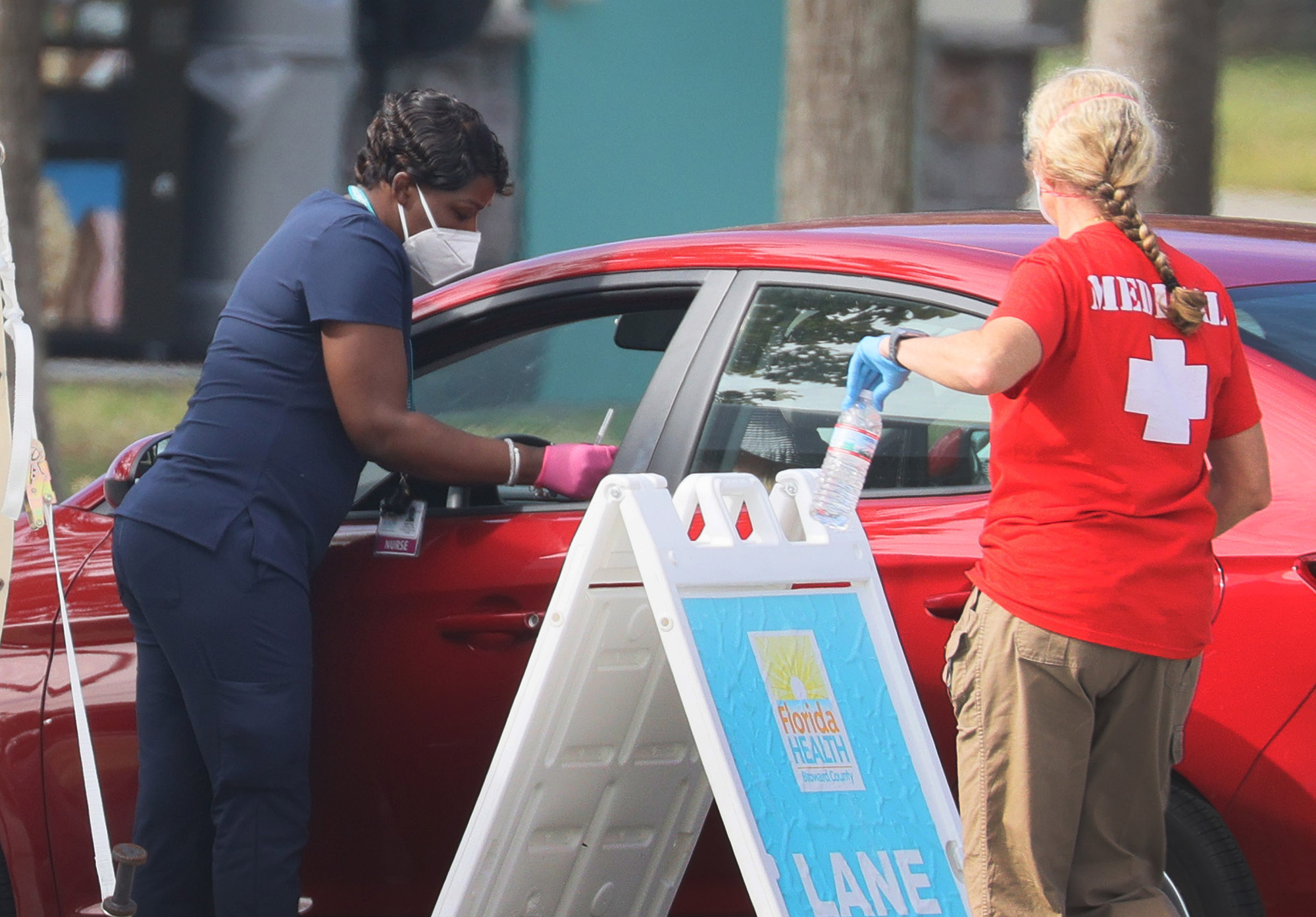 A healthcare worker with the Florida Department of Health in Broward prepares to administer a COVID-19 vaccine at a drive-thru vaccination site in Davie, Florida, on Tuesday, January 4.