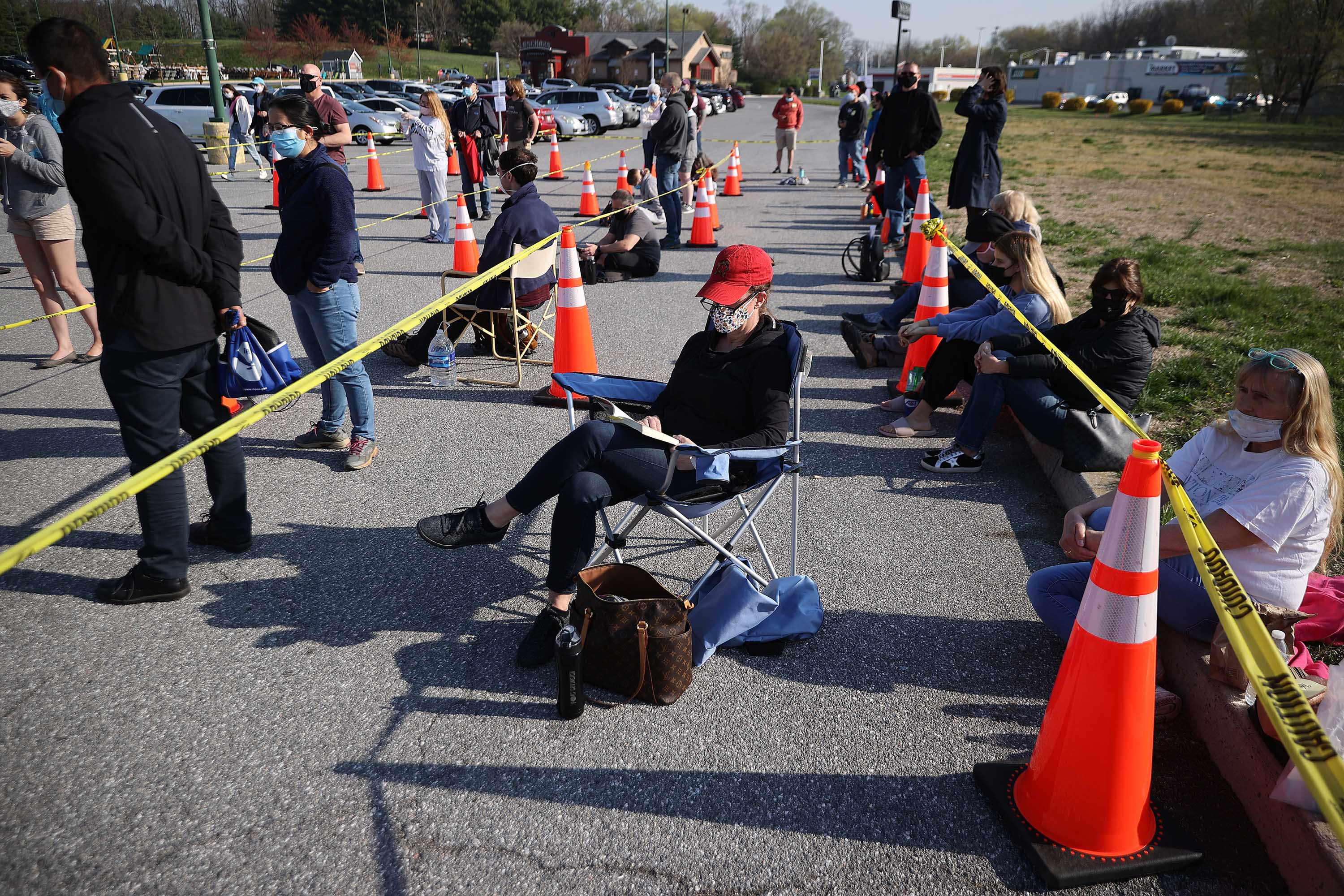 People wait outside a mass coronavirus vaccination site in Hagerstown, Maryland, on April 7.