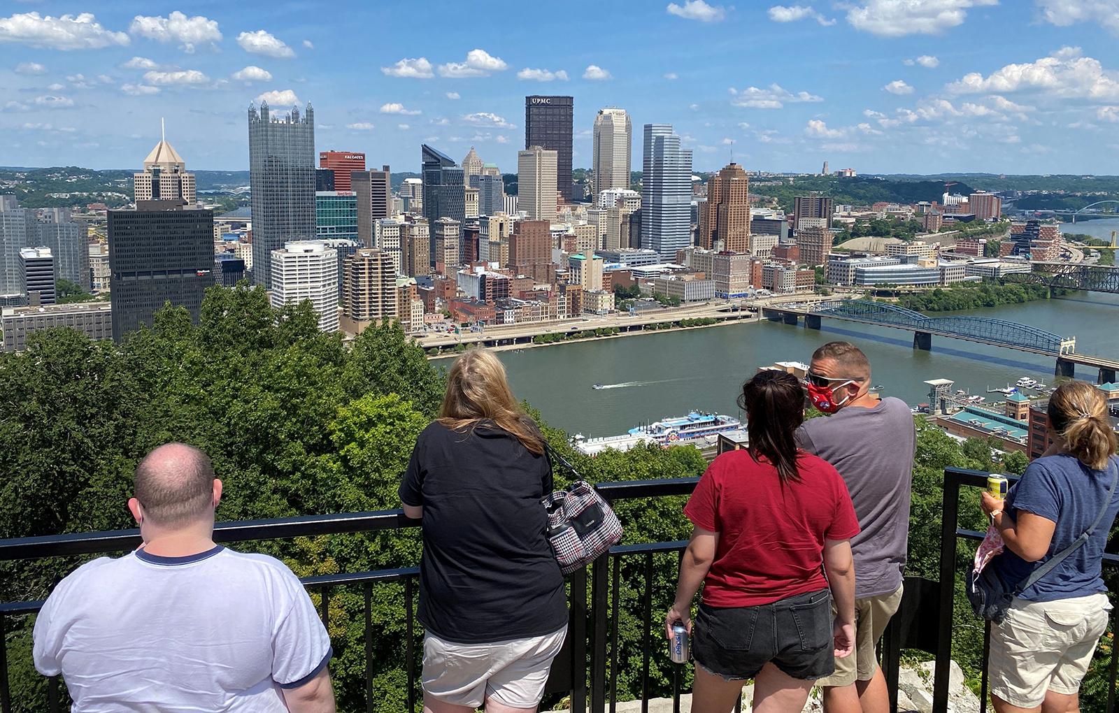 Tourists take photos of downtown Pittsburgh, Pennsylvania, on Saturday, July 25, amid the Coronavirus outbreak.