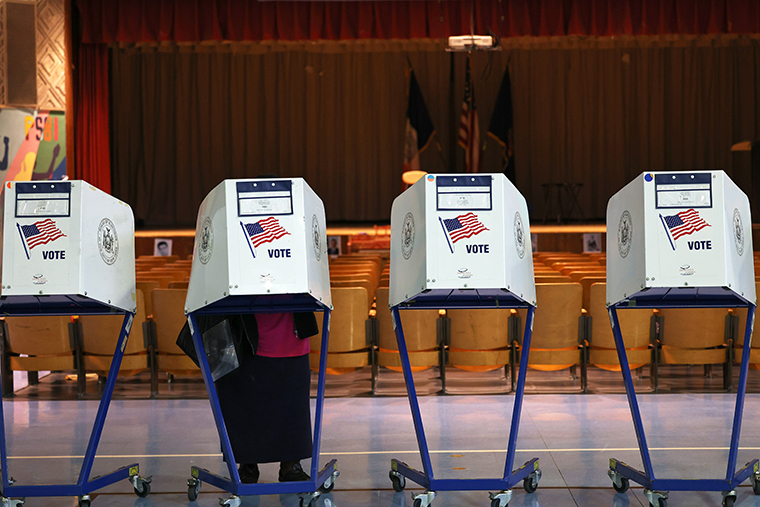 People vote during the Primary Election Day at P.S. 81 on June 22, 2021 in the Bedford-Stuyvesant neighborhood of Brooklyn borough in New York City.