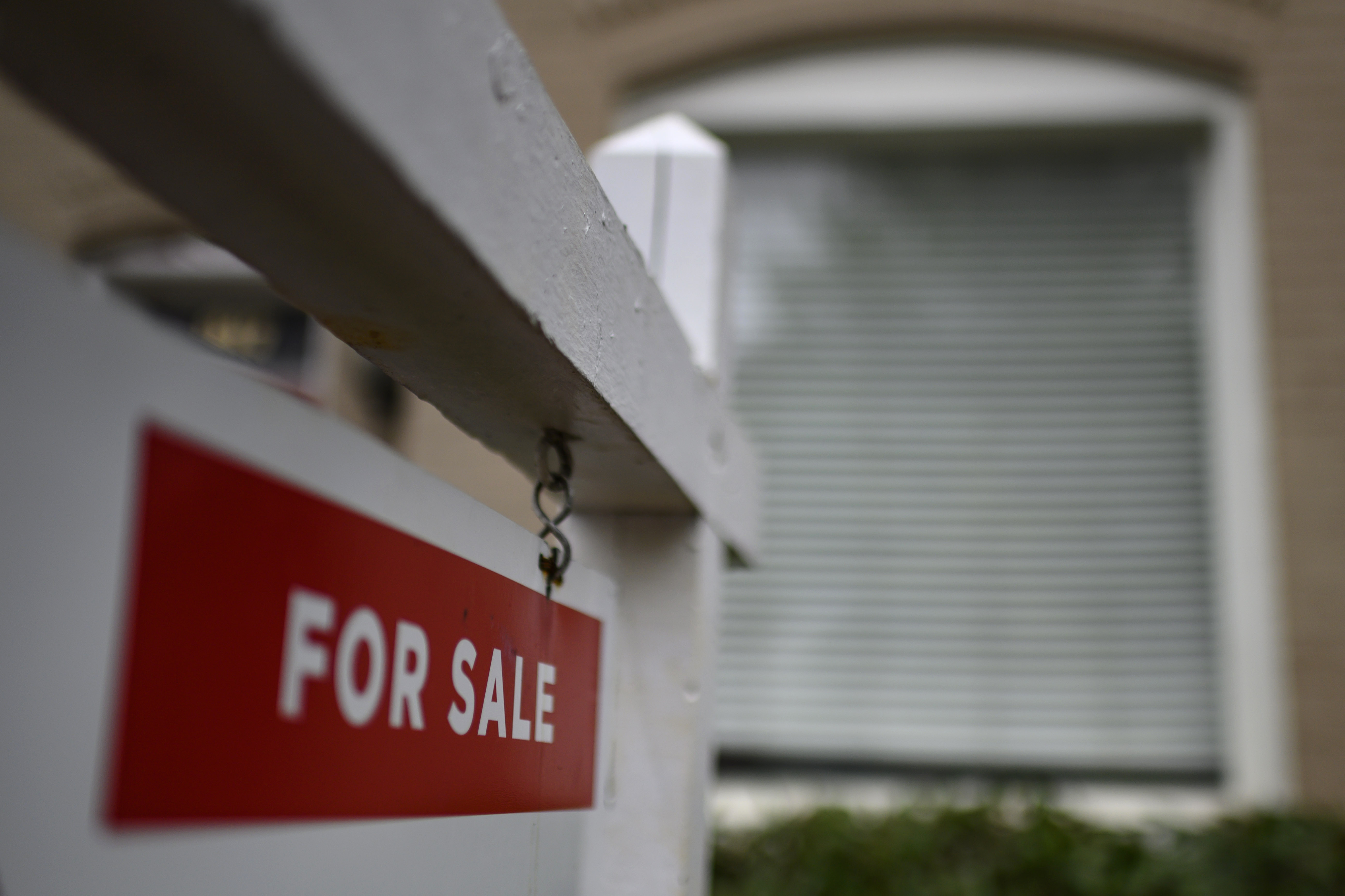 """A """"for sale"""" sign is displayed in front of a home in Washington on April 24."""