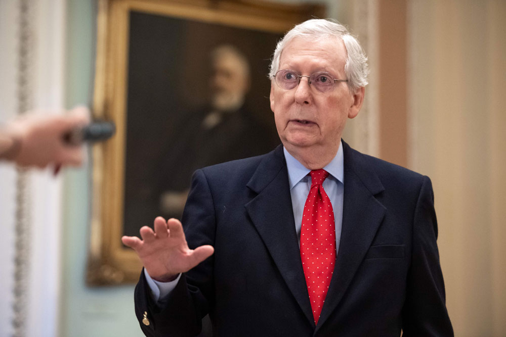 Senat Majority Leader Mitch McConnell speaks to reporters after leaving the Senate floor at the US Capitol in Washington on April 9.