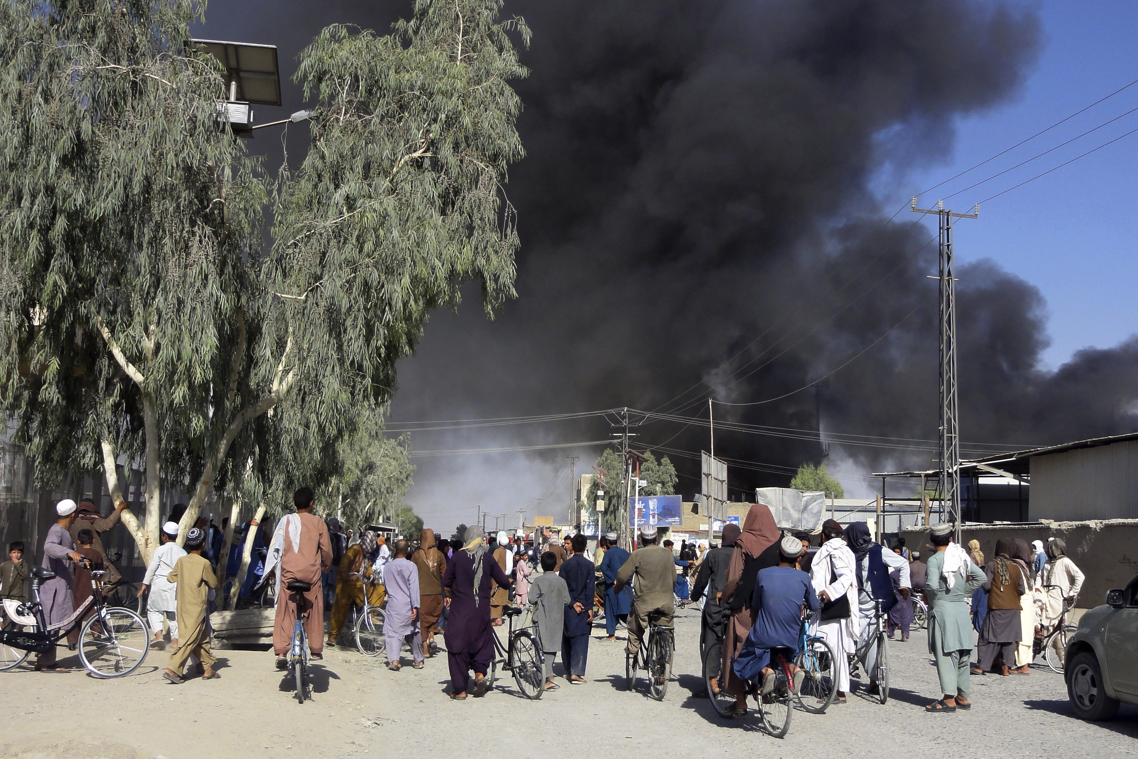 Smoke rises after fighting between the Taliban and Afghan security personnel, in Kandahar, Afghanistan, on Thursday, August 12, 2021.