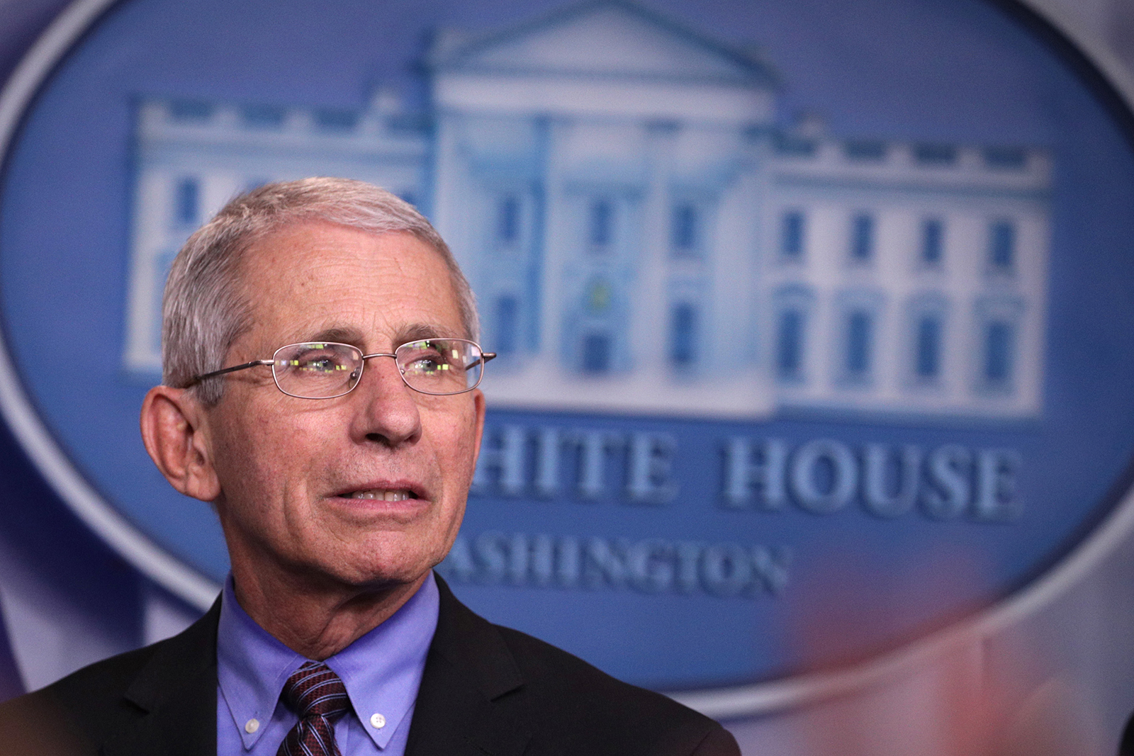 National Institute of Allergy and Infectious Diseases Director Anthony Fauci listens during the daily coronavirus briefing at the White House on April 9, in Washington.
