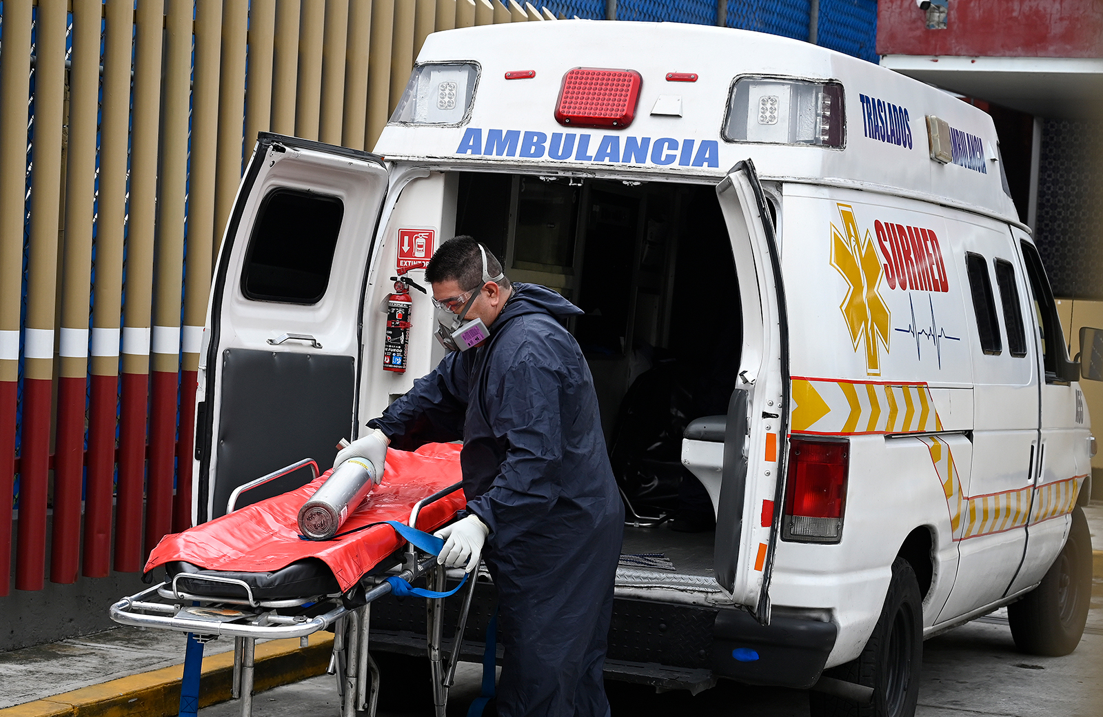 A paramedic prepares to move a patient at the Covid-19 triage area of the General Hospital in Mexico City on August 20.