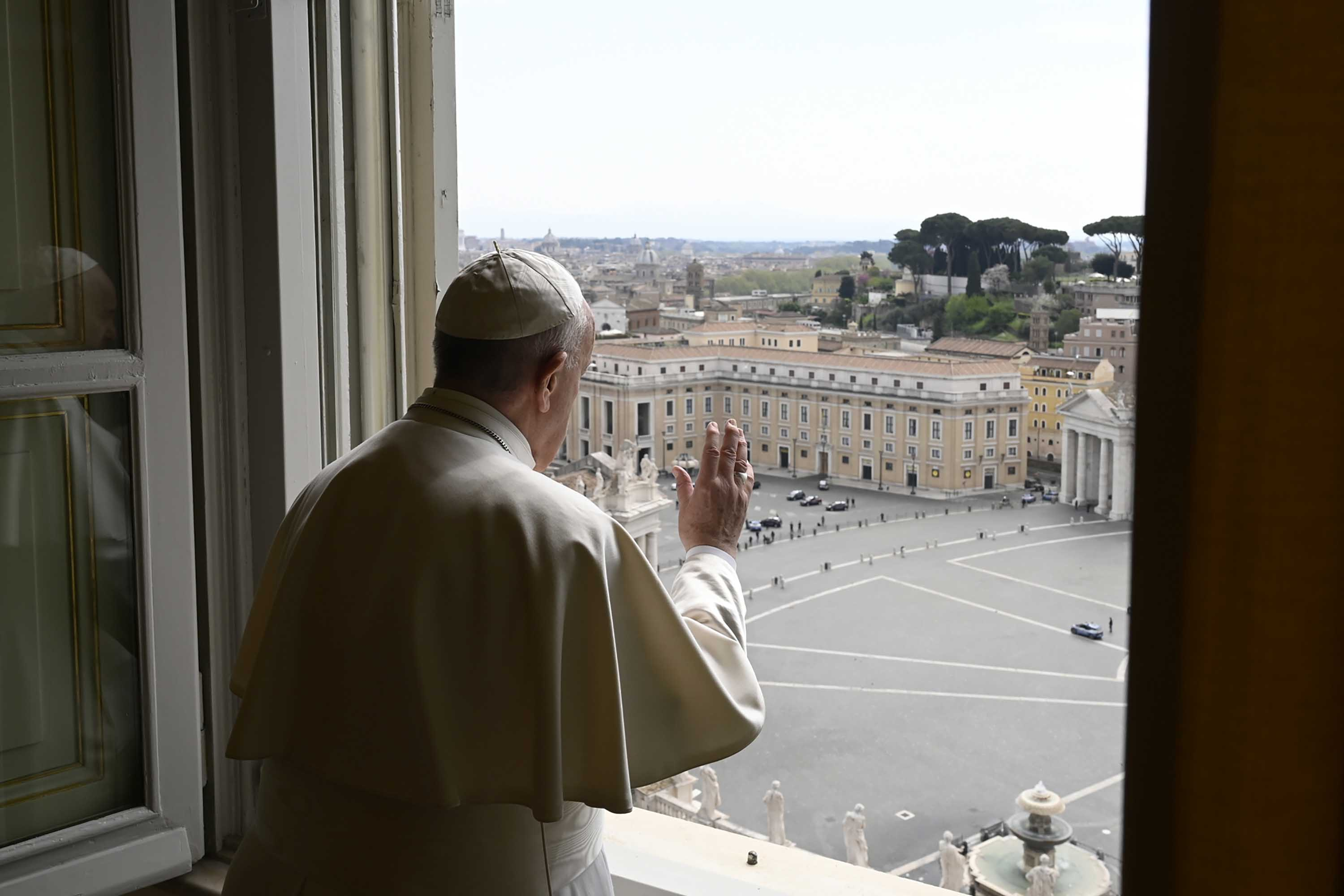 Pope Francis delivers a blessing over an almost empty St. Peter's Square at the Vatican, on April 13.