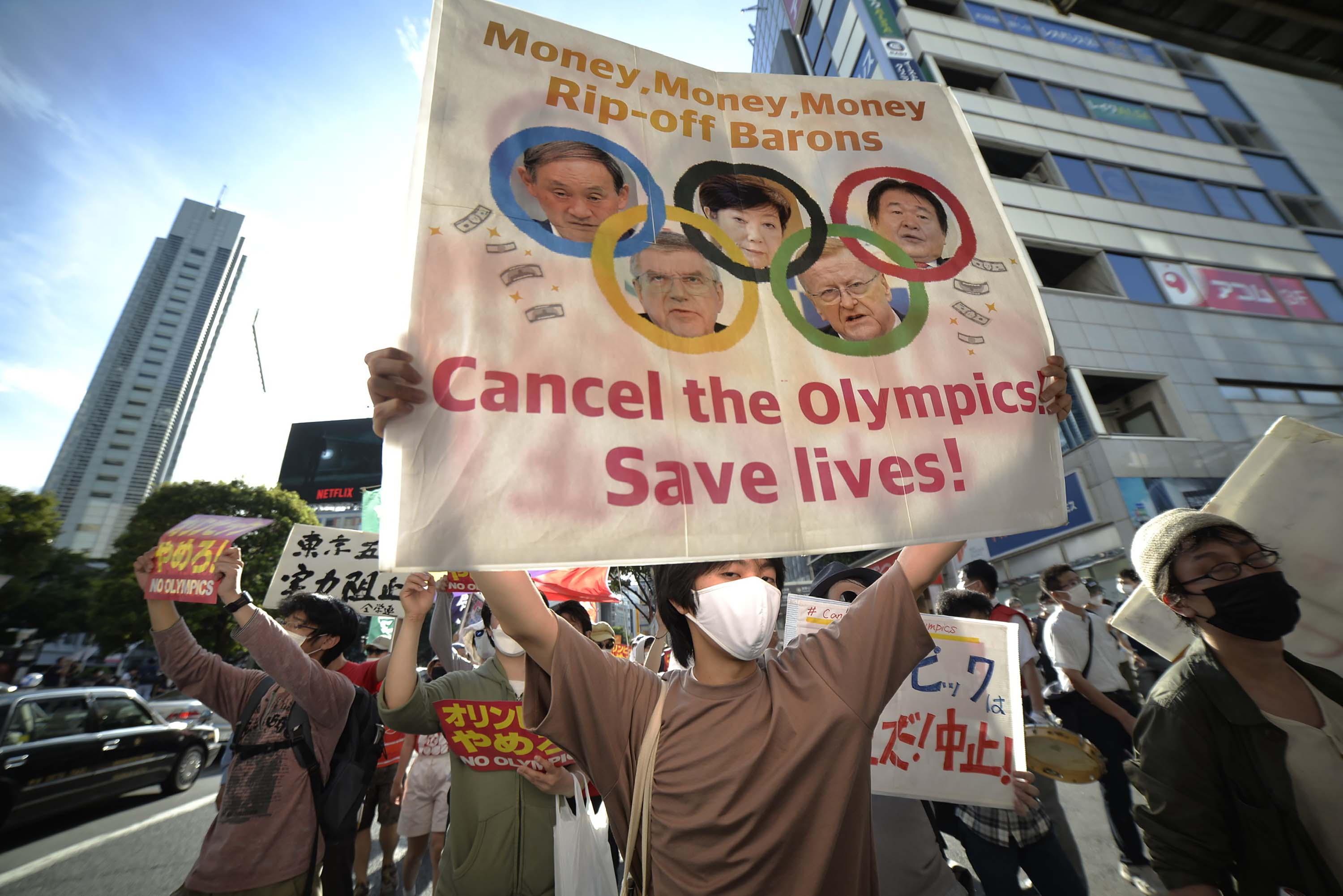 People protest ahead of the Opening Ceremony of the 2020 Tokyo Summer Olympics on July 23, in Tokyo, Japan.