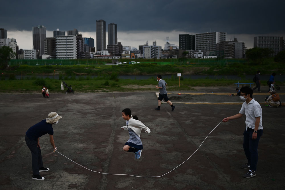 A girl jumps rope by the Tamagawa riverside in Tokyo on May 5.