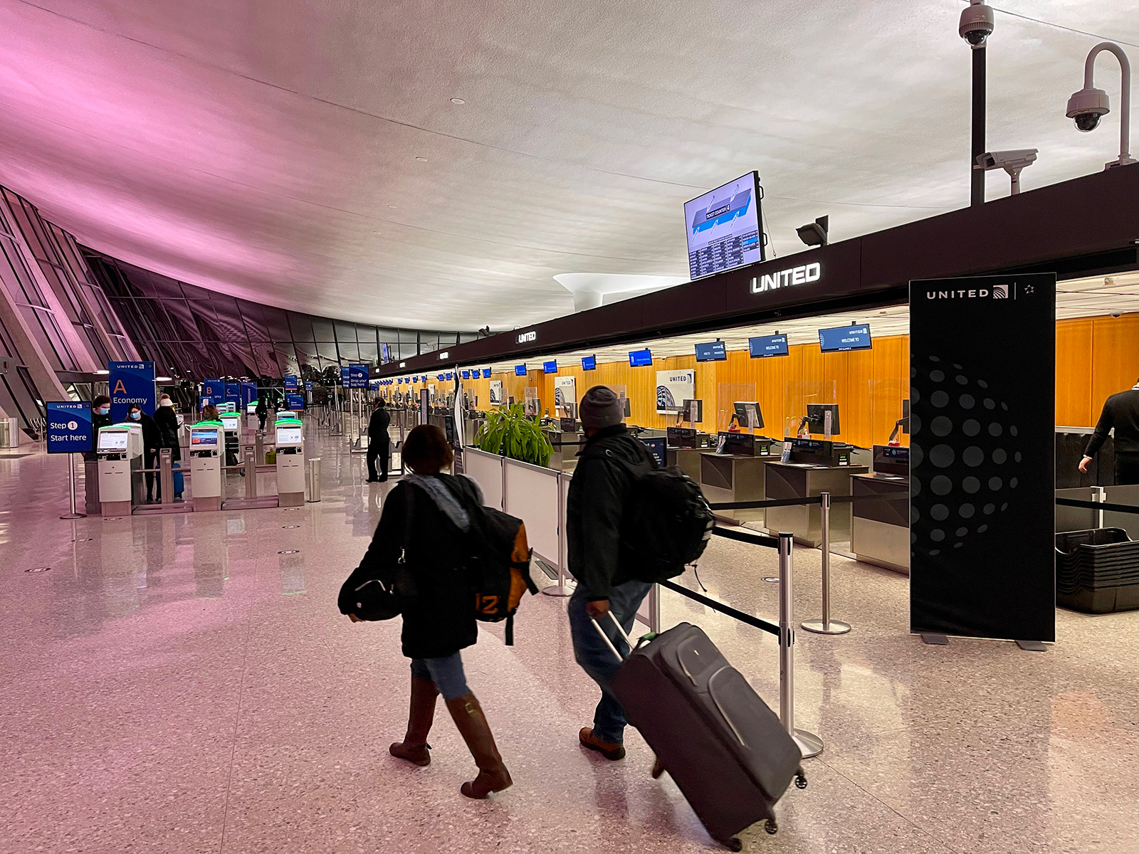 Travelers walk past a United Airlines counter at Washington's Dulles International Airport in Virginia on March 2.