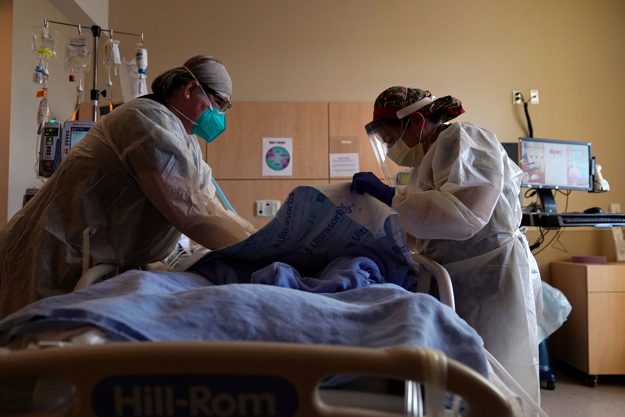 Registered nurses treat a Covid-19 patient at Providence Holy Cross Medical Center on December 22, 2020 in Los Angeles, California.