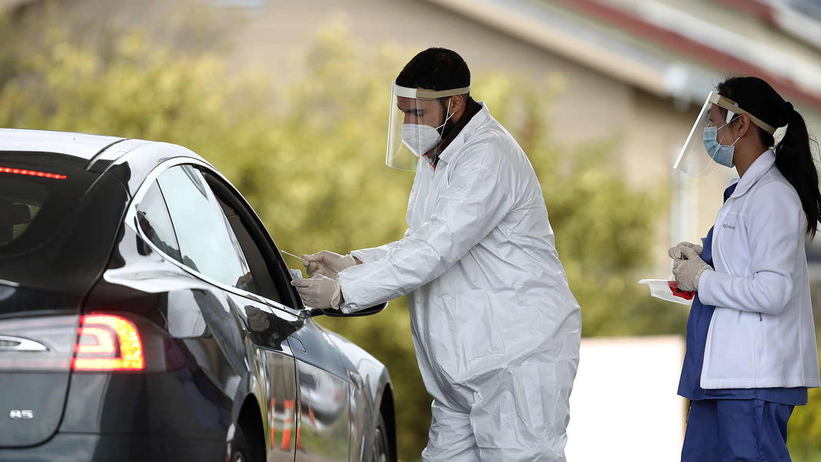 A medical professional administers a coronavirus test at a drive-through testing location in Bolinas, California on April 20.