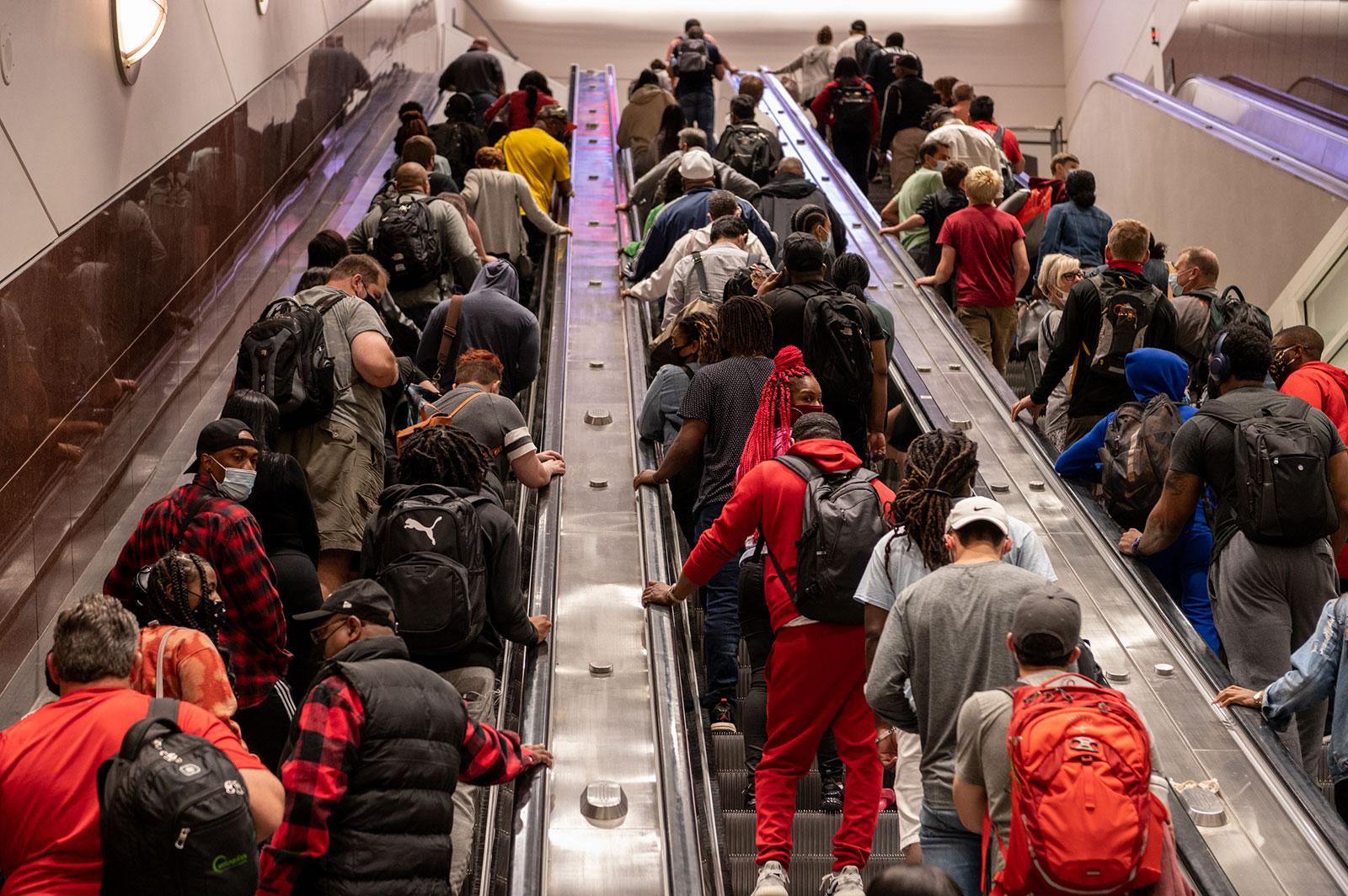 People ride escalators at Atlanta's Hartsfield-Jackson International Airport on Friday, May 28.