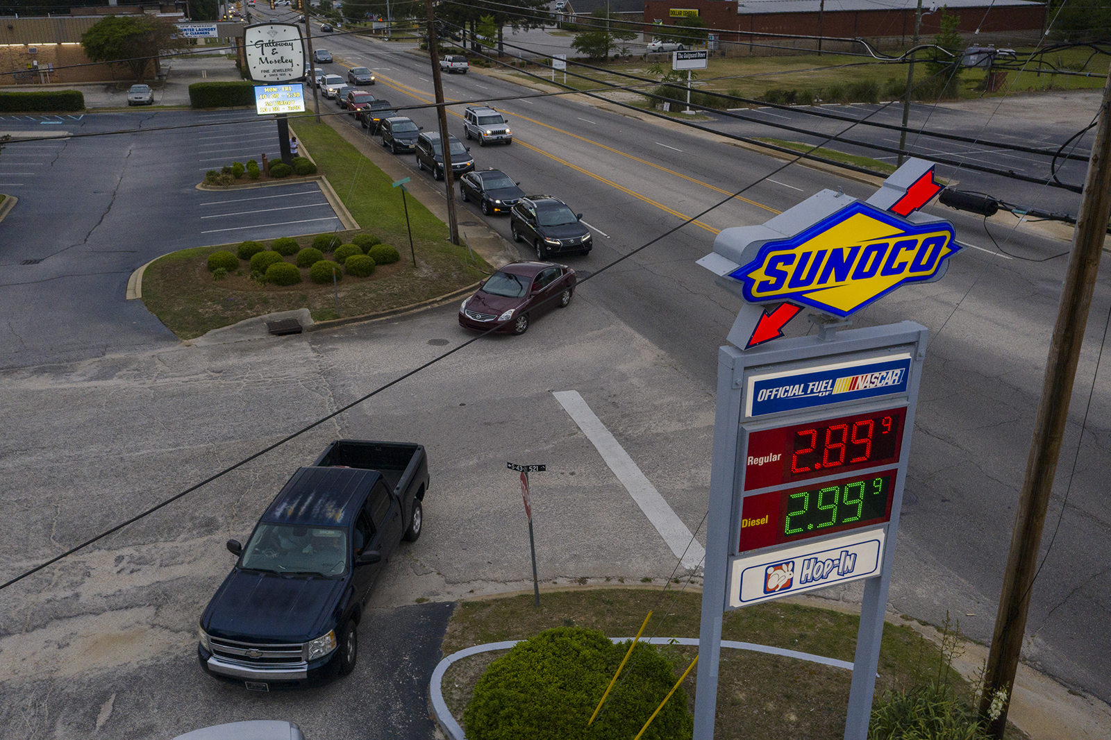 Vehicles line up to get fuel at a Sunoco gas station in Sumter, South Carolina on Tuesday, May 11.
