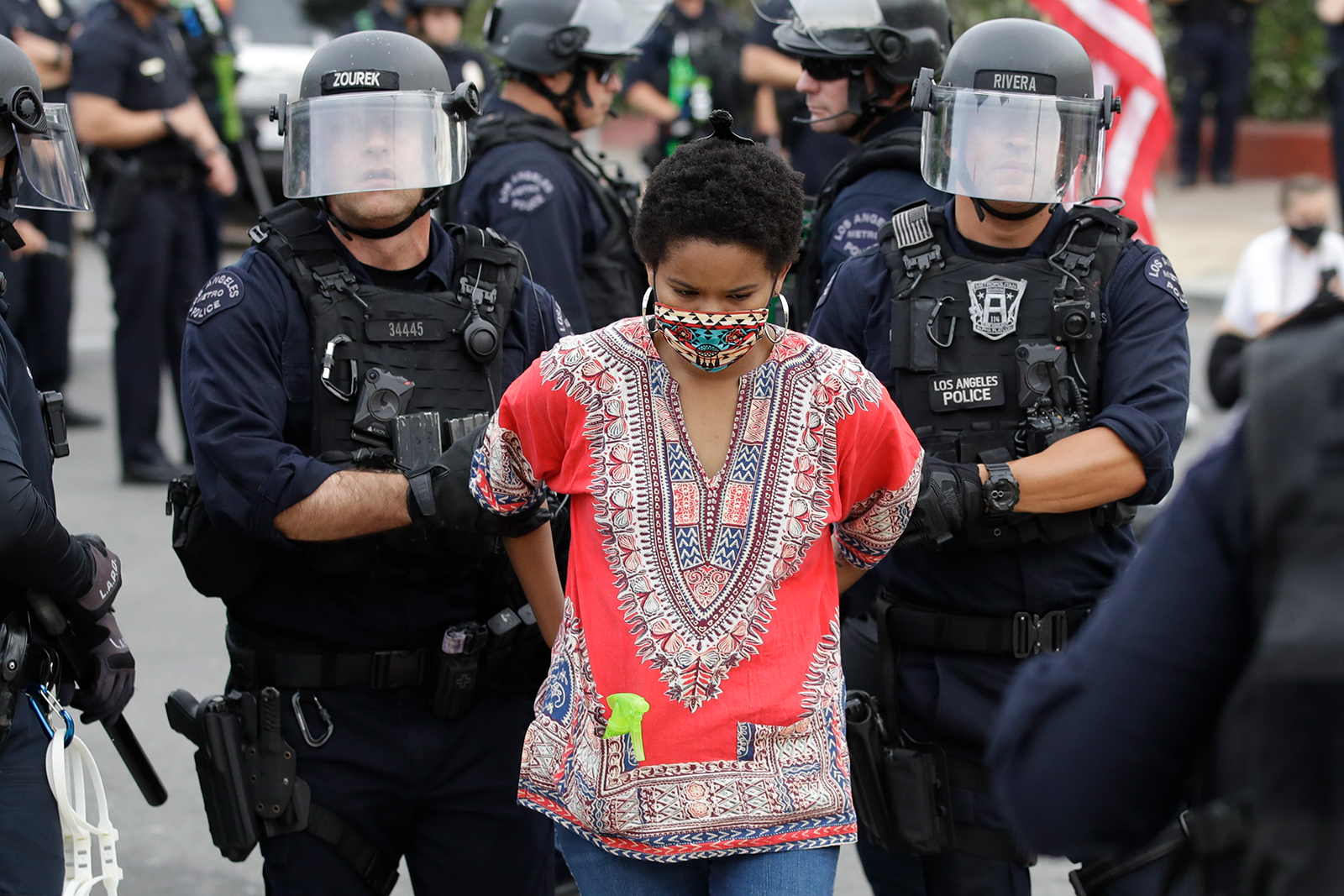 A protester is arrested for violating a curfew on Monday, June 1, in the Hollywood area of Los Angeles.