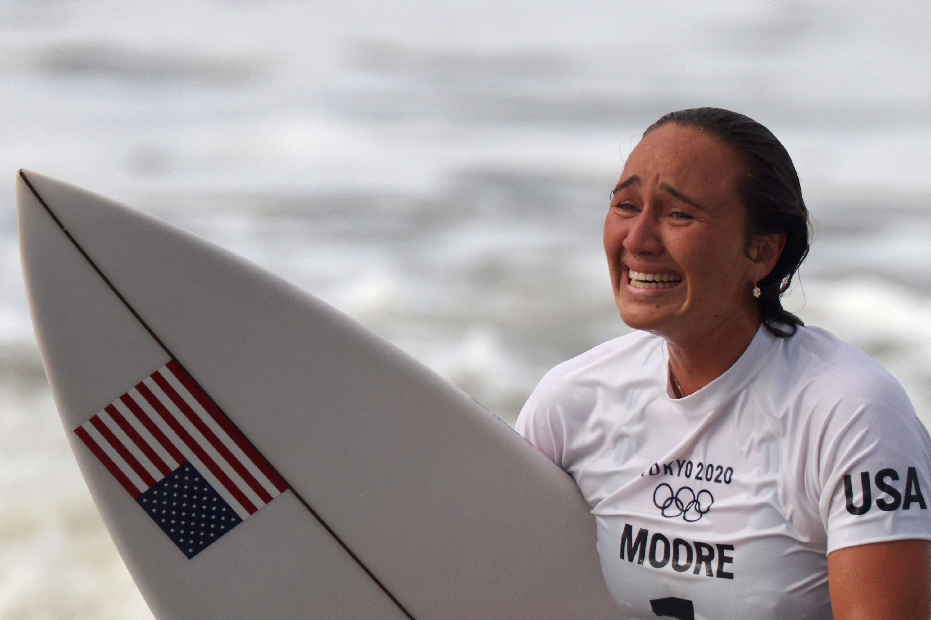 US' Carissa Moore makes wins the first women's Olympic surfing gold