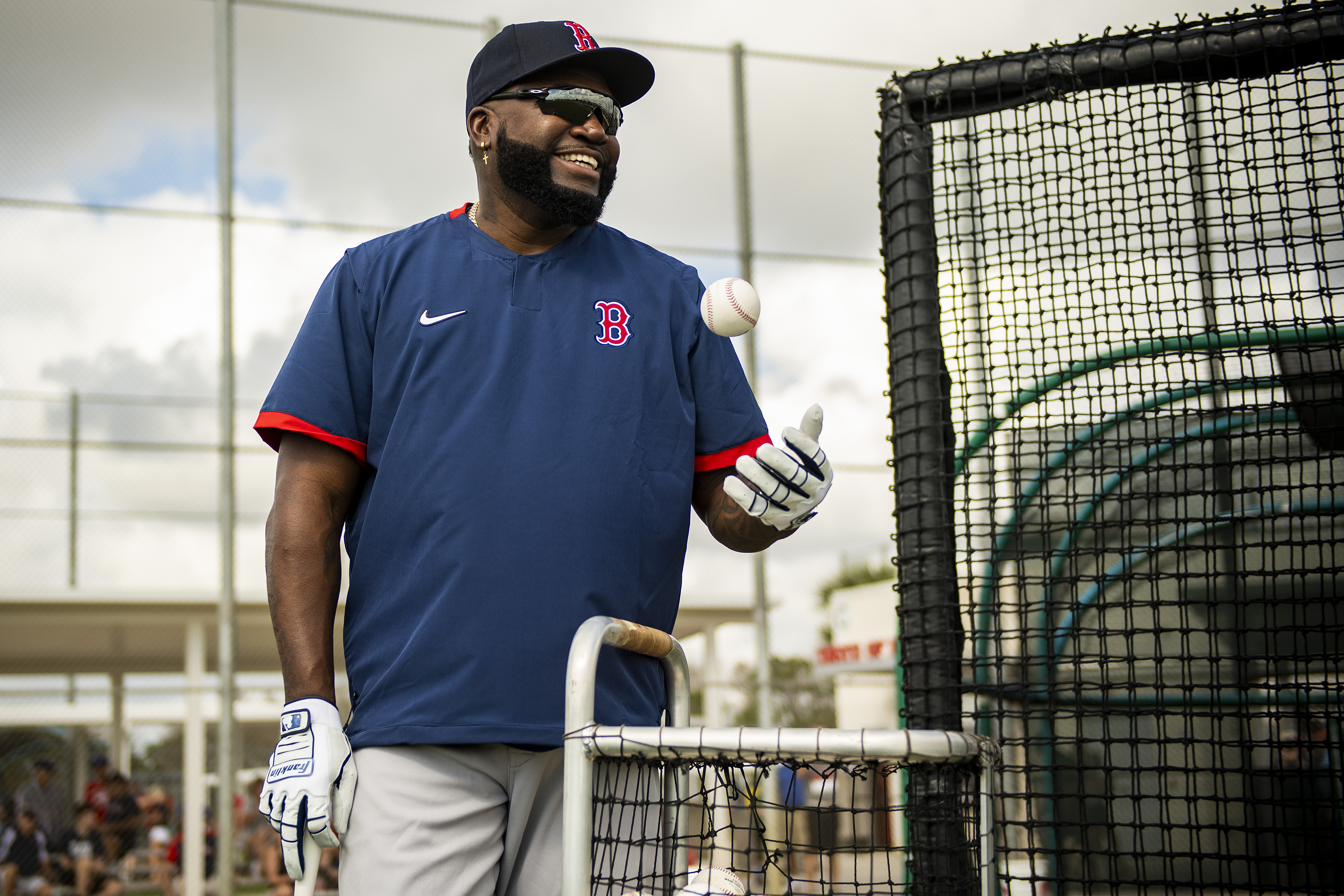 Former designated hitter David Ortiz of the Boston Red Sox smiles during a team workout on February 20 in Fort Myers, Florida.