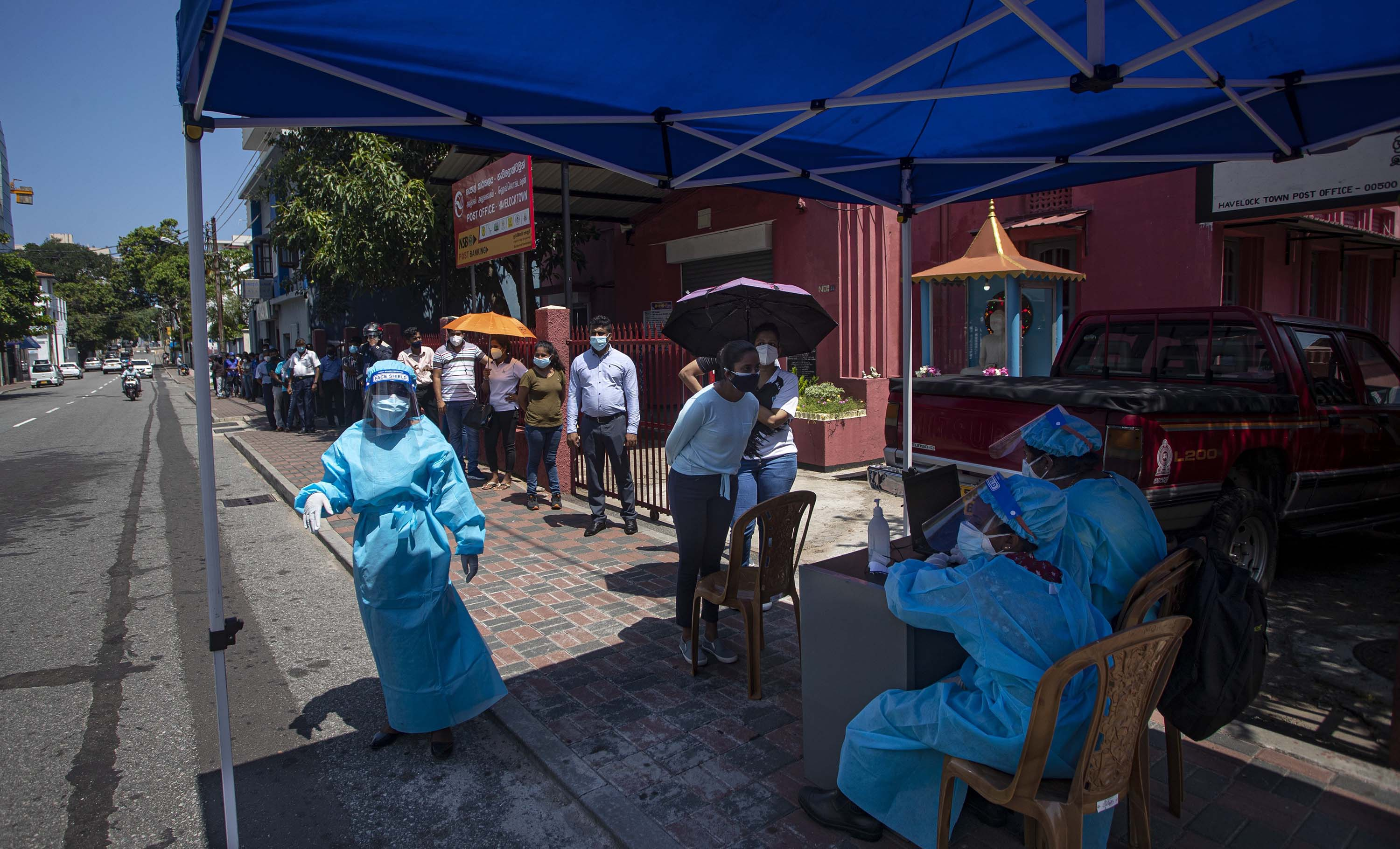 People queue at a roadside screening point to get tested for Covid-19 in Colombo, Sri Lanka, on April 27.