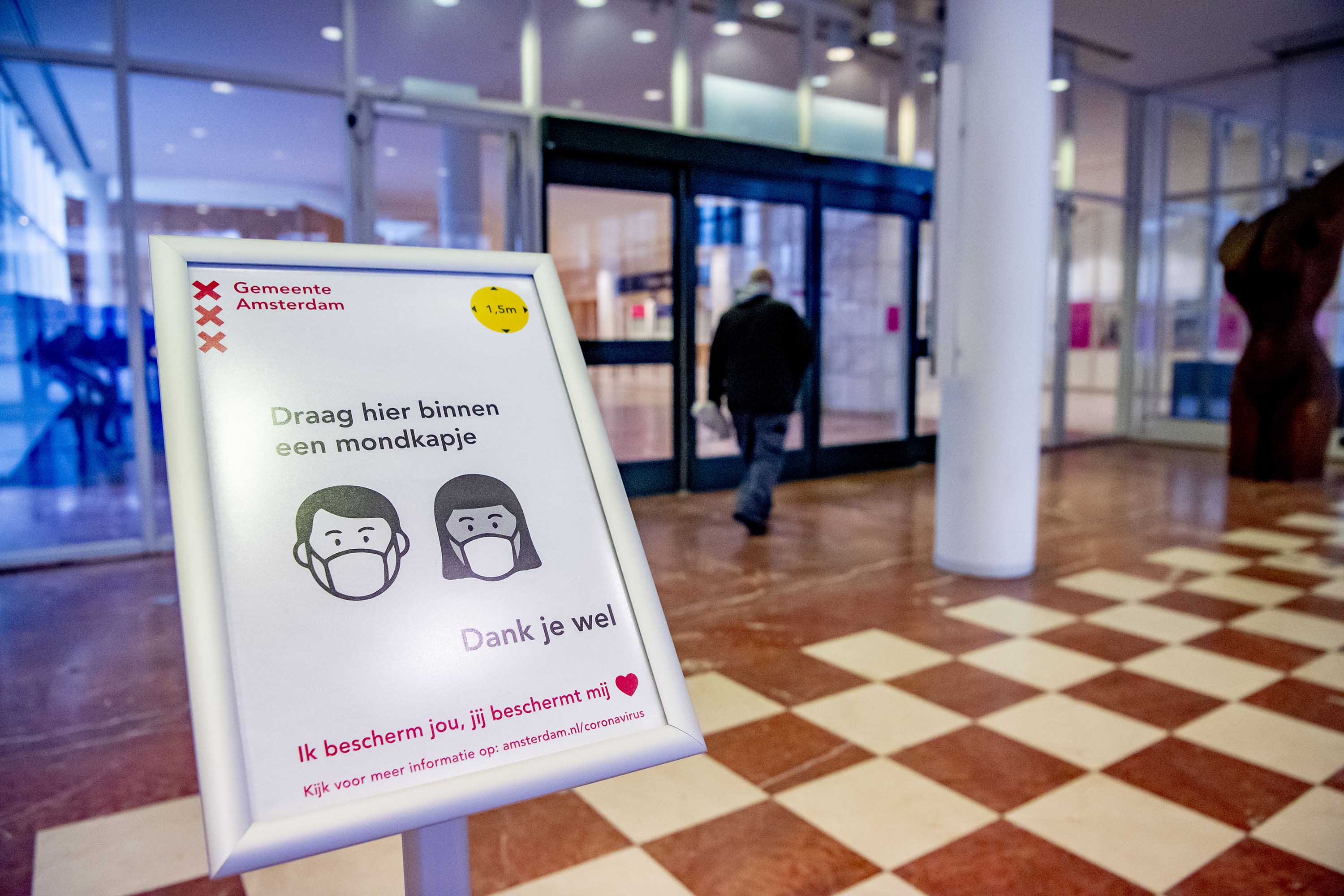 A notice about wearing face masks is displayed in Amsterdam, The Netherlands, on November 30.