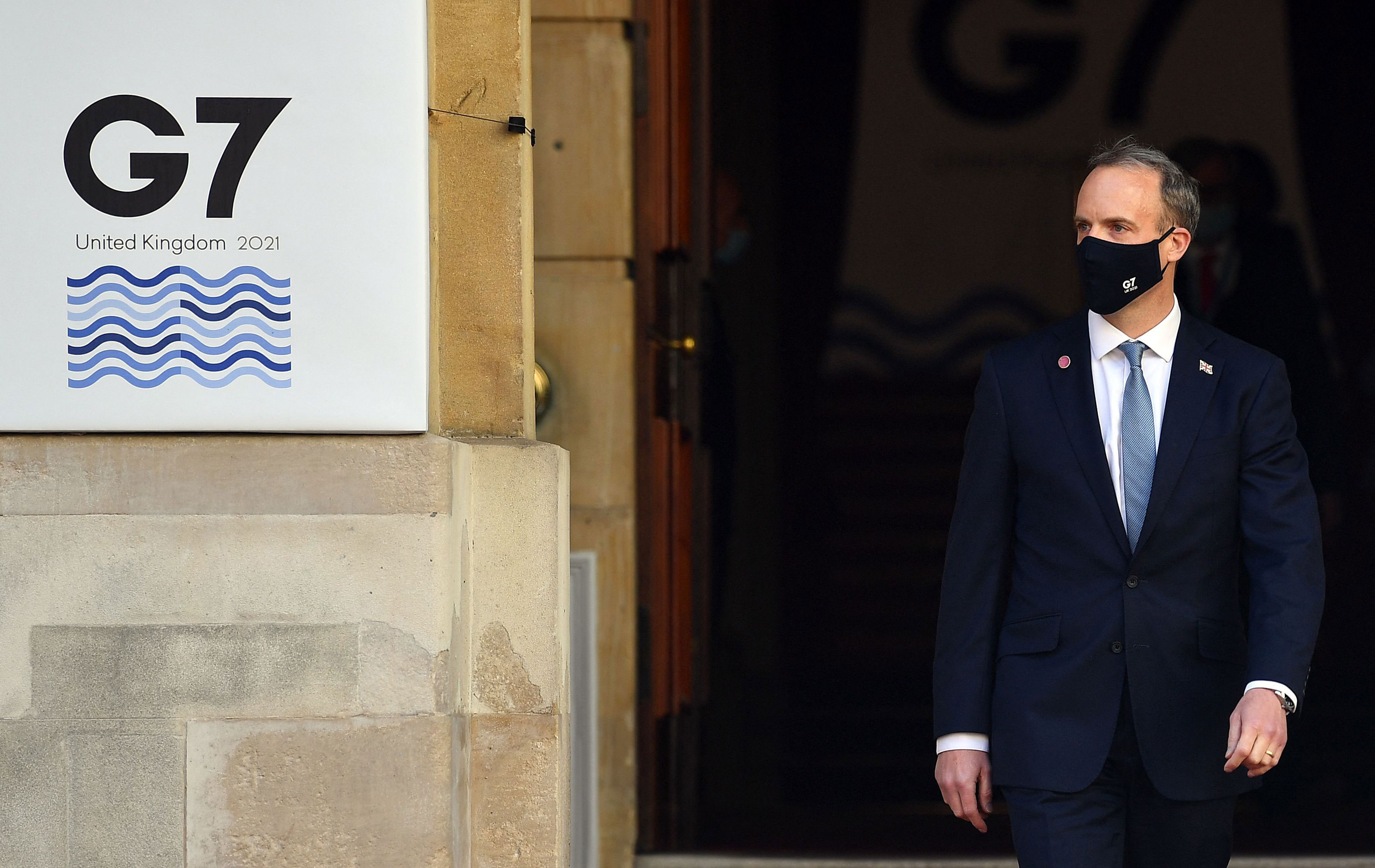 British Foreign Secretary Dominic Raab waits to greet participants at the G7 foreign ministers' meeting in London on May 5.