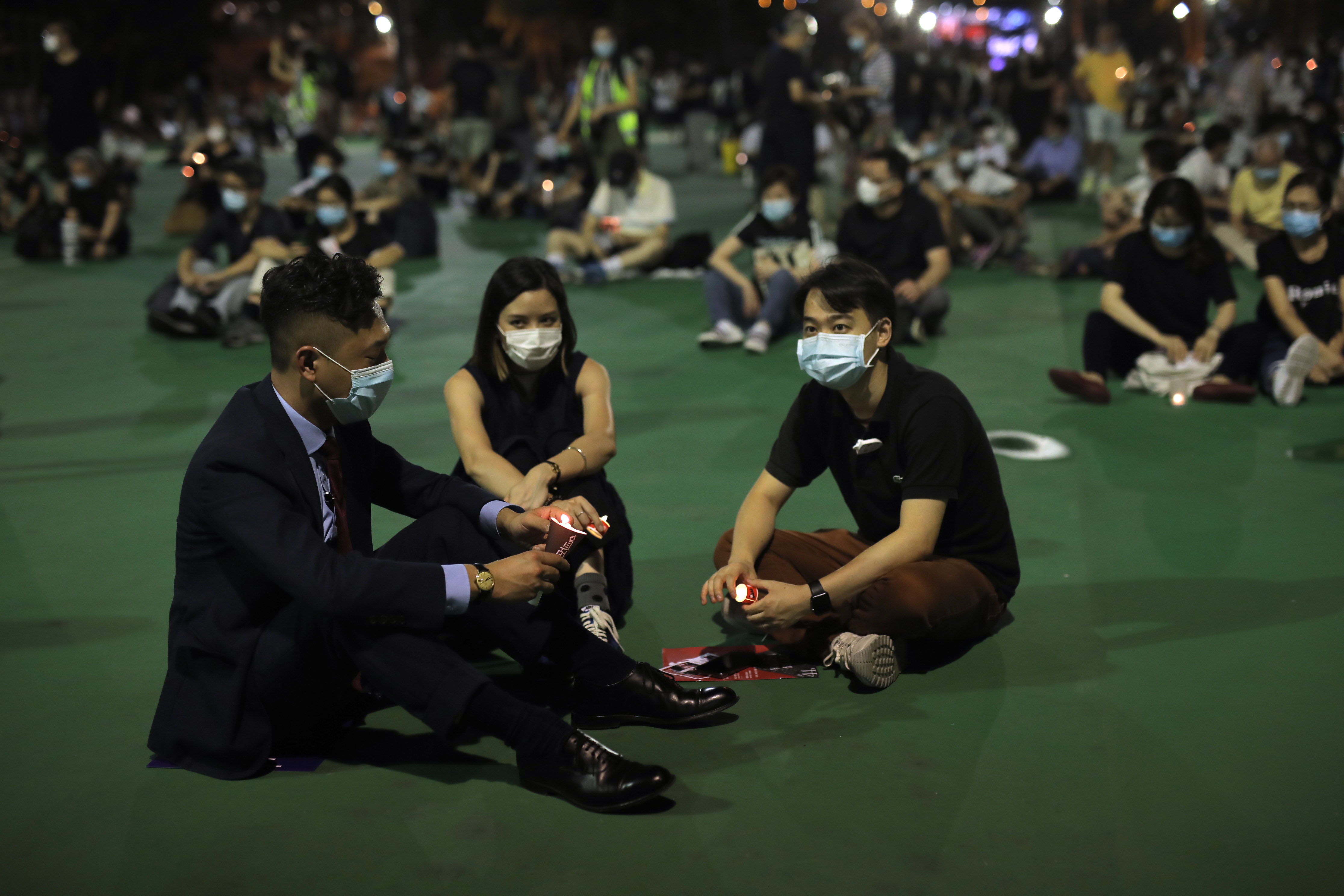 People hold candles during a vigil to remember the victims of the 1989 Tiananmen Square massacre, at Victoria Park in Hong Kong on June 4.