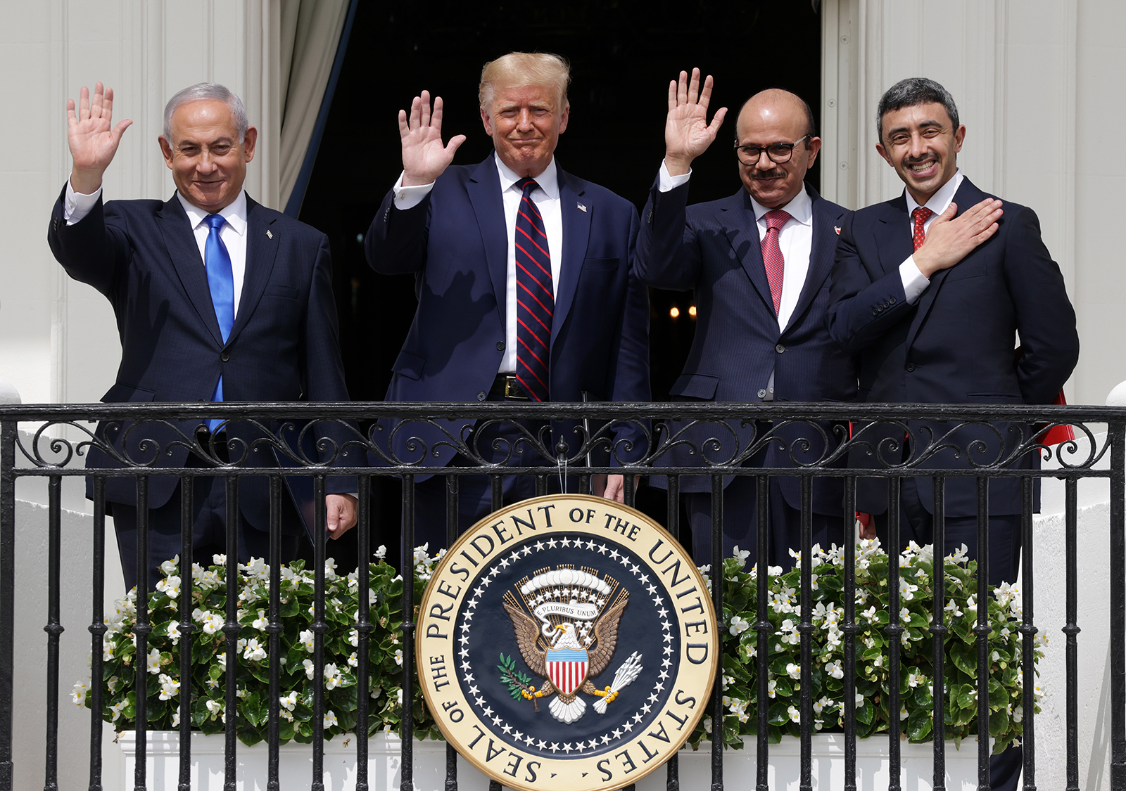 (Left to Right) Prime Minister of Israel Benjamin Netanyahu, US President Donald Trump, Foreign Affairs Minister of Bahrain Abdullatif bin Rashid Al Zayani, and Foreign Affairs Minister of the United Arab Emirates Abdullah bin Zayed bin Sultan Al Nahyan wave from the Truman Balcony of the White House on September 15 .