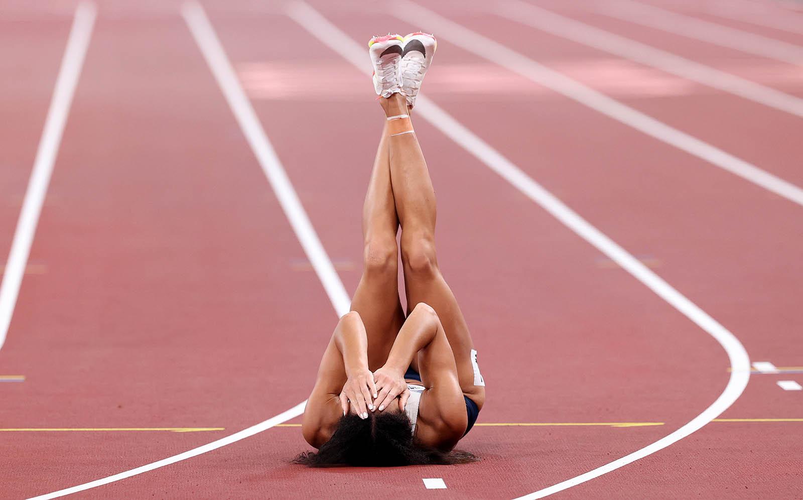 Katarina Johnson-Thompson of Great Britain sustains an injury in the women's heptathlon 200m event on August 4.