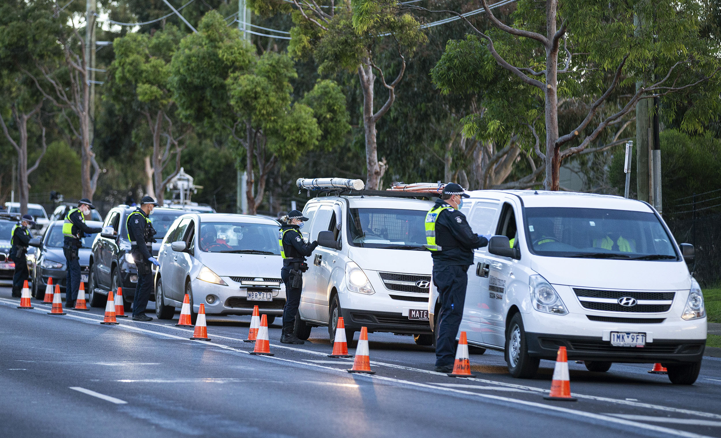 Police check drivers at a roadblock in Melbourne, Australia, on Thursday, on July 2.