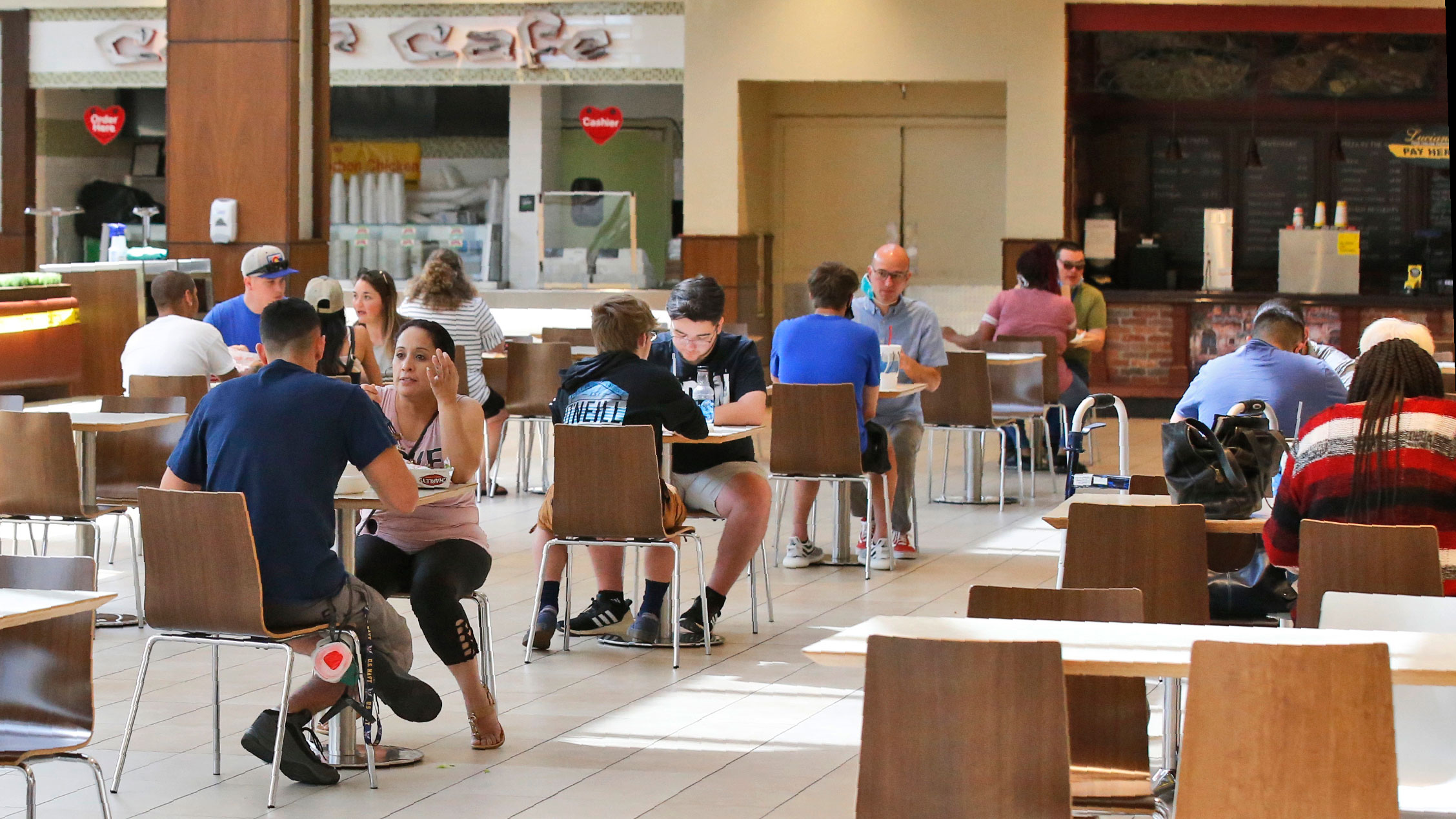 People eat in the food court of the recently reopened Penn Square Mall on May 1 in Oklahoma City.
