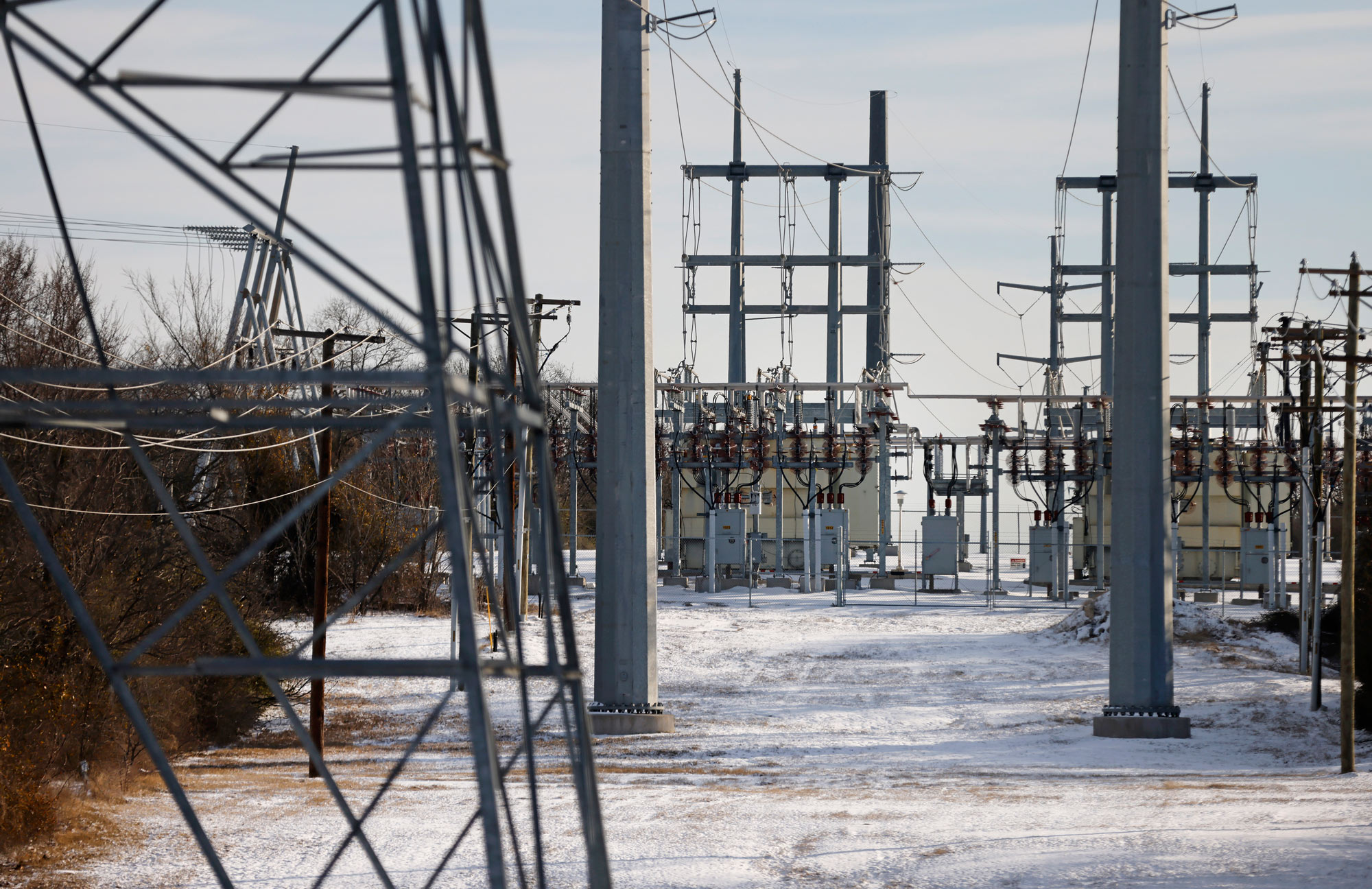 Transmission towers and power lines lead to a substation on February 16 in Fort Worth, Texas.