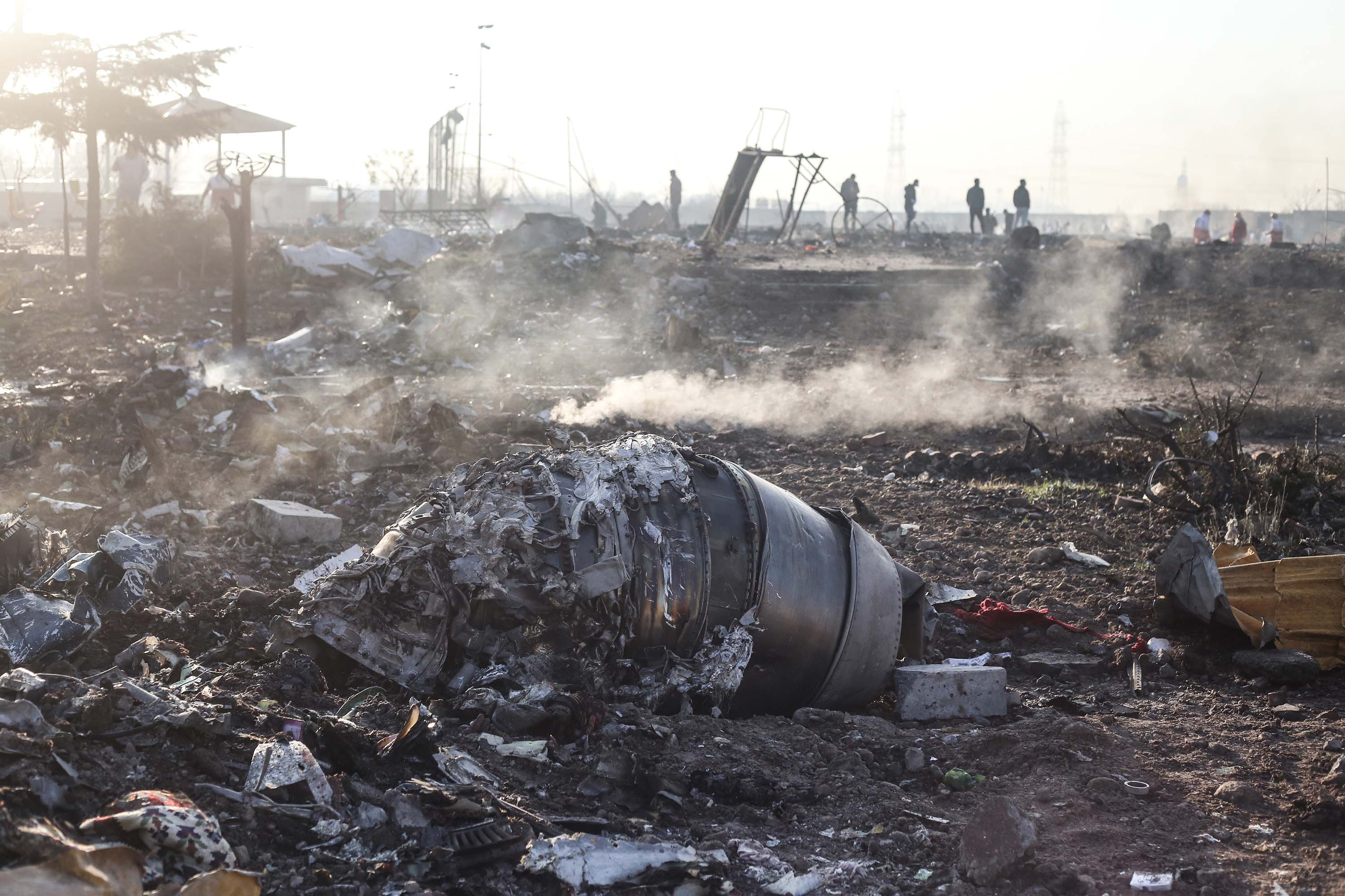 Wreckage from the aircraft lay at the scene of the crash on Wednesday.
