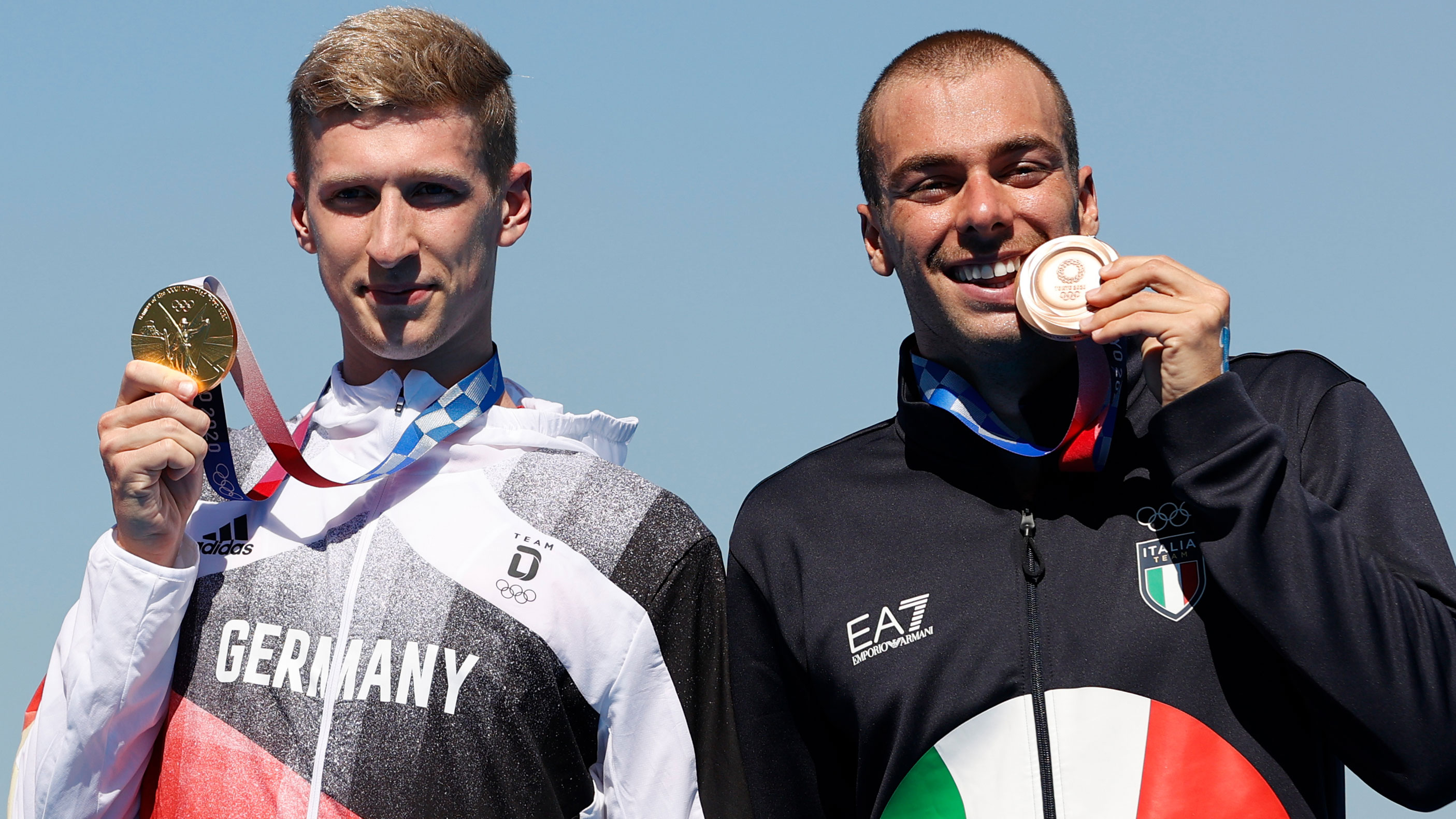 Germany's Florian Wellbrock and Italy's Gregorio Paltrinieri pose for photos with their gold and bronze medals for the 10-kilometer swimming event on August 5.