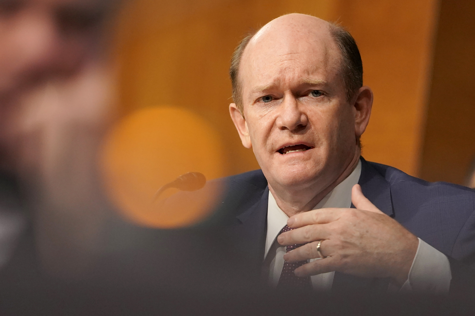 Sen. Chris Coons asks a question to Secretary of State Mike Pompeo during a Senate Foreign Relations to discuss the Trump administration's FY 2021 budget request for the State Department on July 30, in Washington.