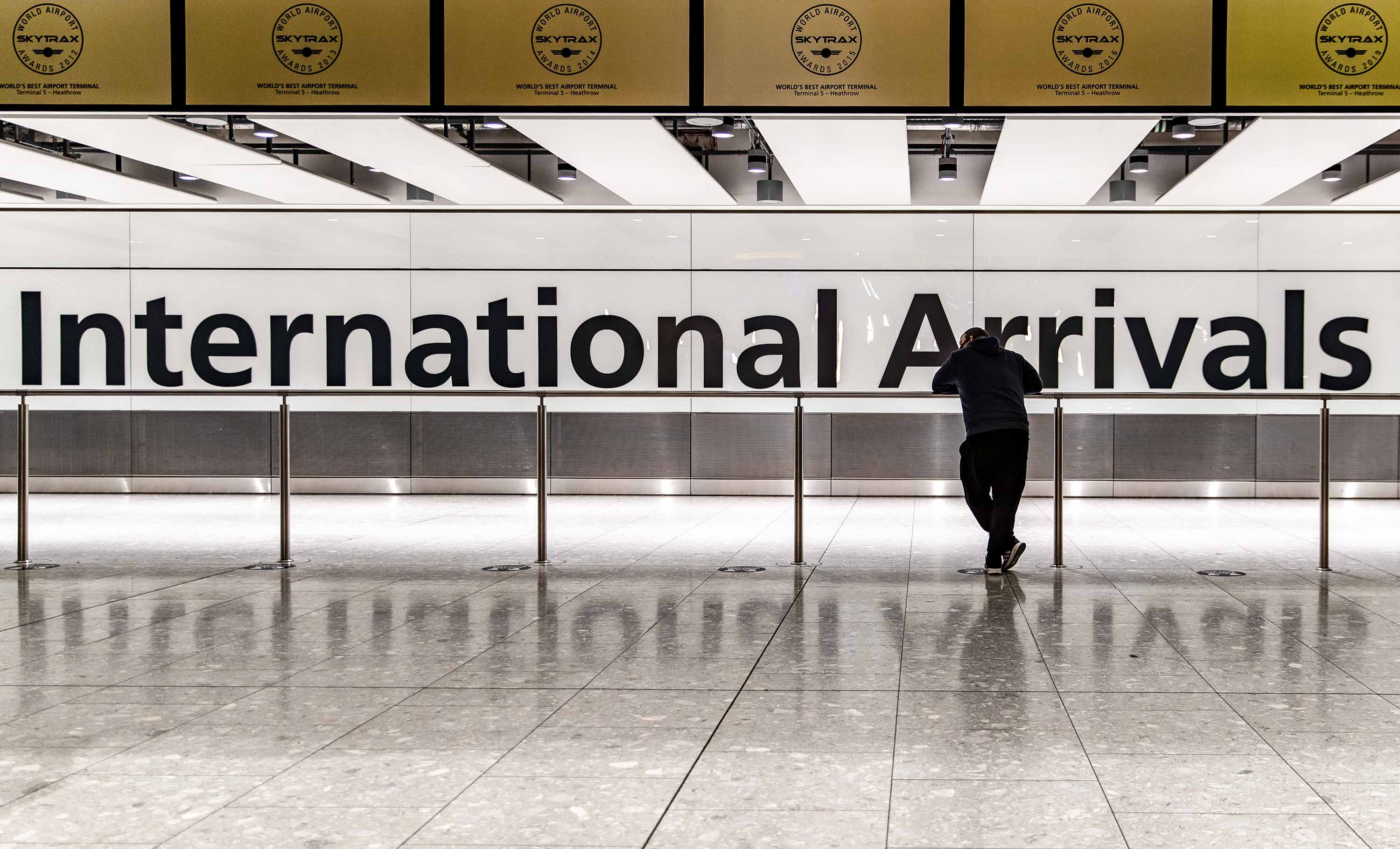 A person waits at the Heathrow Airport international arrival hall in London, on January 29.