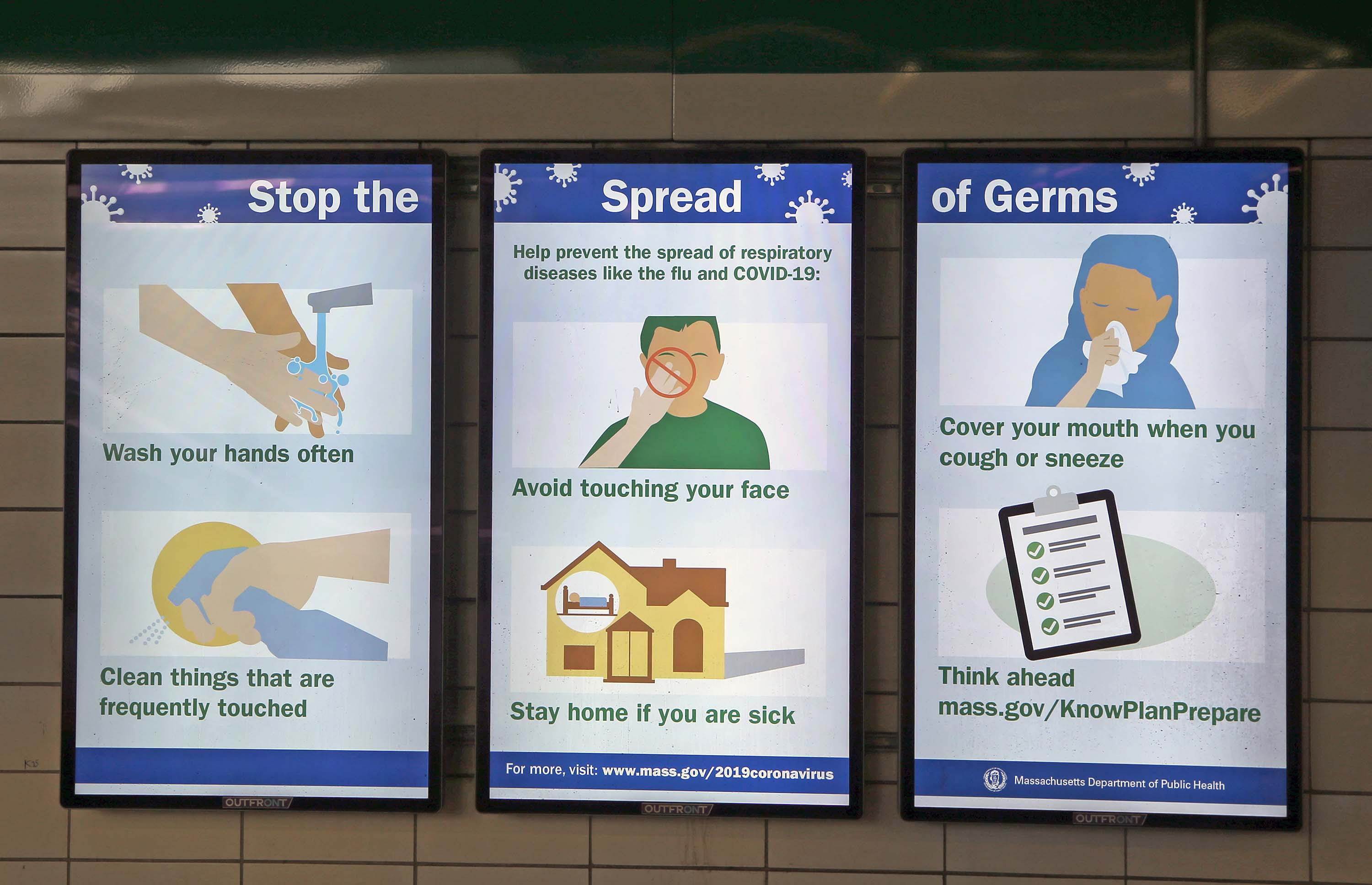 A sign listing ways to stop the spread of germs is seen in a subway station in Boston, on March 5.