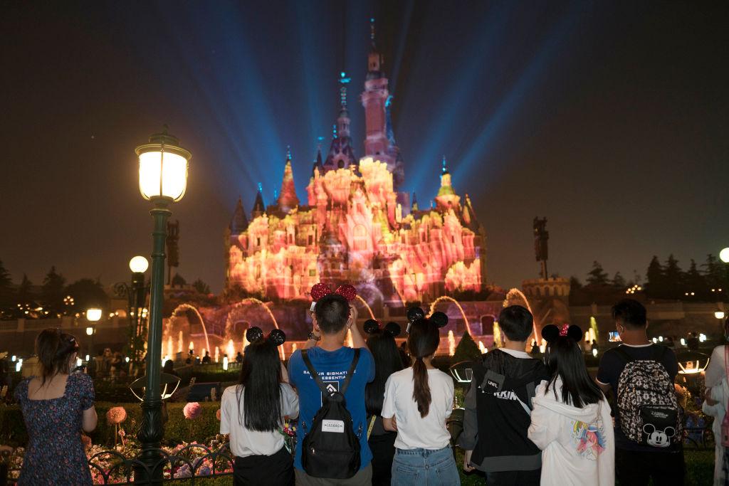 Tourists at Shanghai Disneyland on May 11.