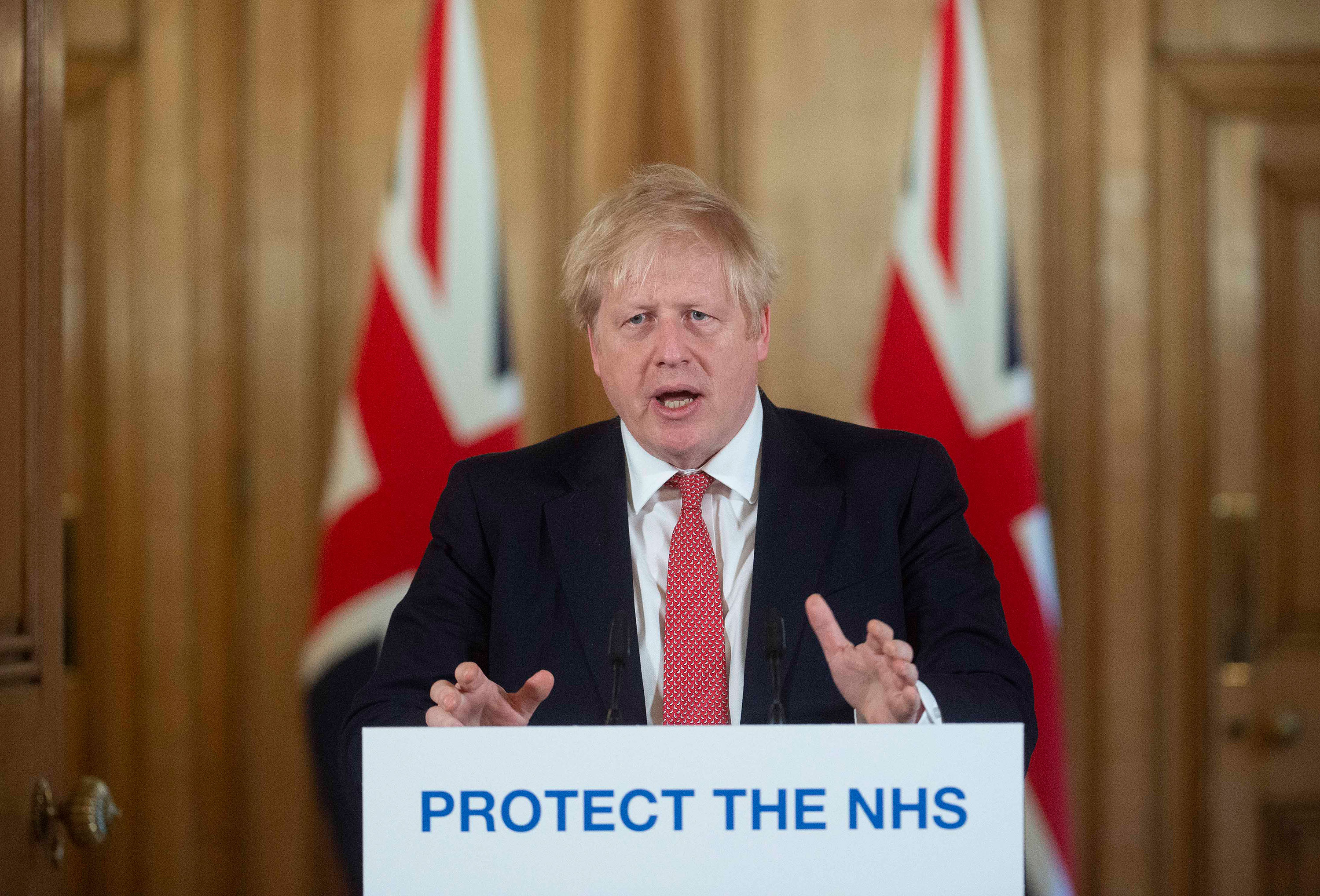 British Prime Minister Boris Johnson speaks during a daily press conference at 10 Downing Street on March 20 in London, England.