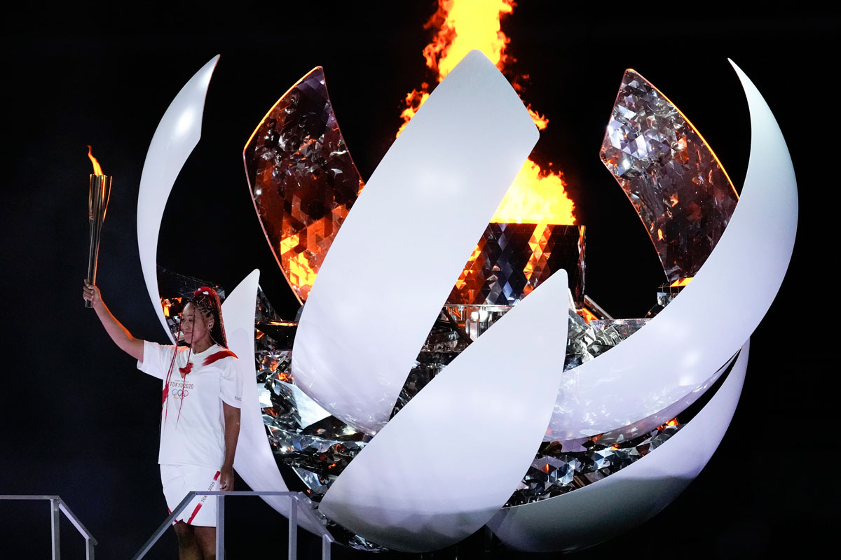 Japan's Naomi Osaka reacts after lighting the cauldron during the opening ceremony at the 2020 Summer Olympics.