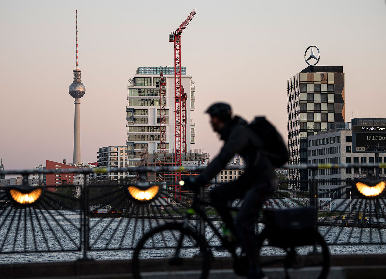 A cyclist crosses the Oberbaum Bridge in Berlin in the early morning of April 14.