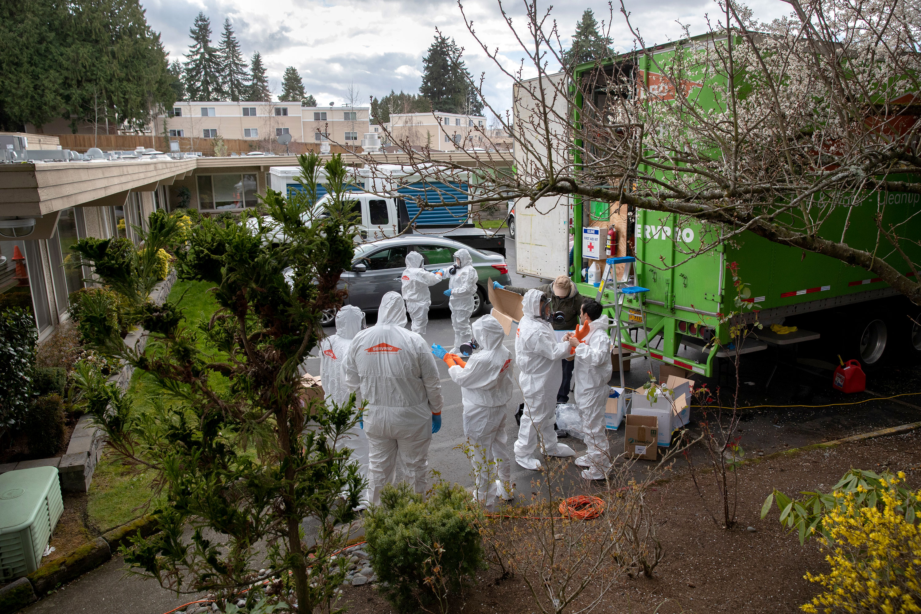 A cleaning crew prepares to enter the Life Care Center in Kirkland, Washington on March 12.