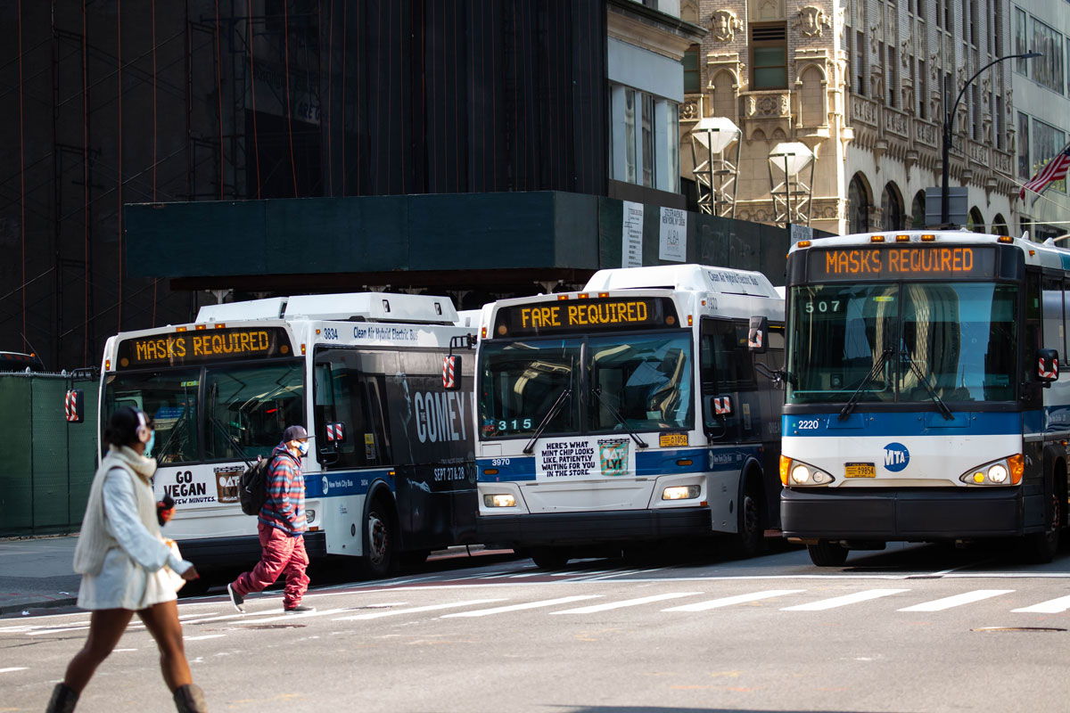 "Buses on 5th Avenue display ""Mask Required"" signs in New York on September 21, 2020."