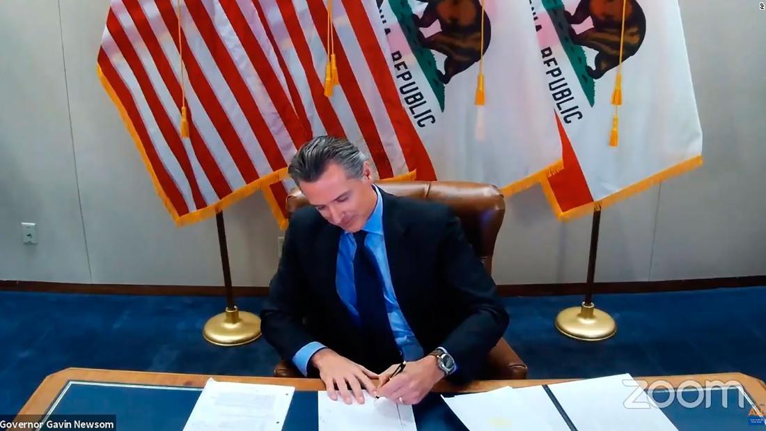 California Gov. Gavin Newsom signing a bill into law on Wednesday, Sept. 30, 2020, in Sacramento, Calif.