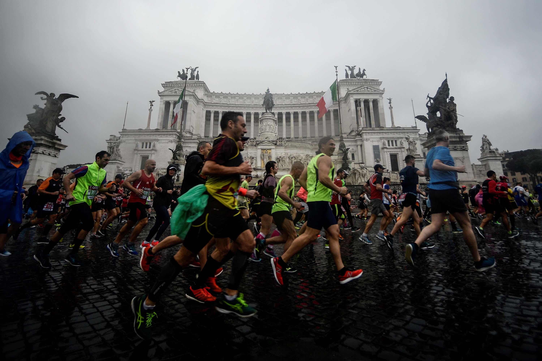 Competitors run past the Altare della Patria monument during the 25th edition of the Rome Marathon in April 2019.