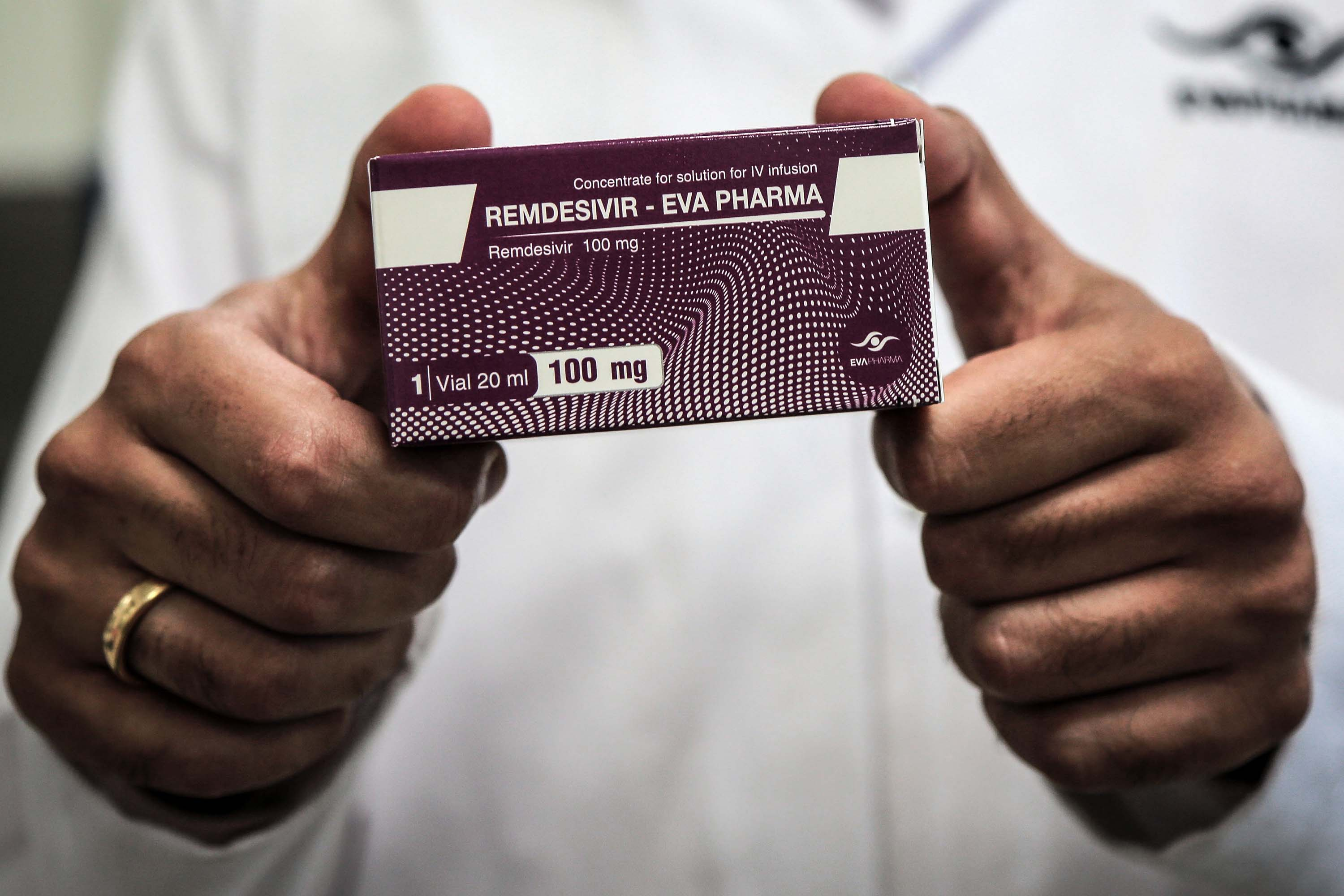 An employee of the Egyptian pharmaceutical company Eva Pharma holds a pack of the antiviral medication remdesivir at the company's factory in Giza, Egypt, in June 2020.
